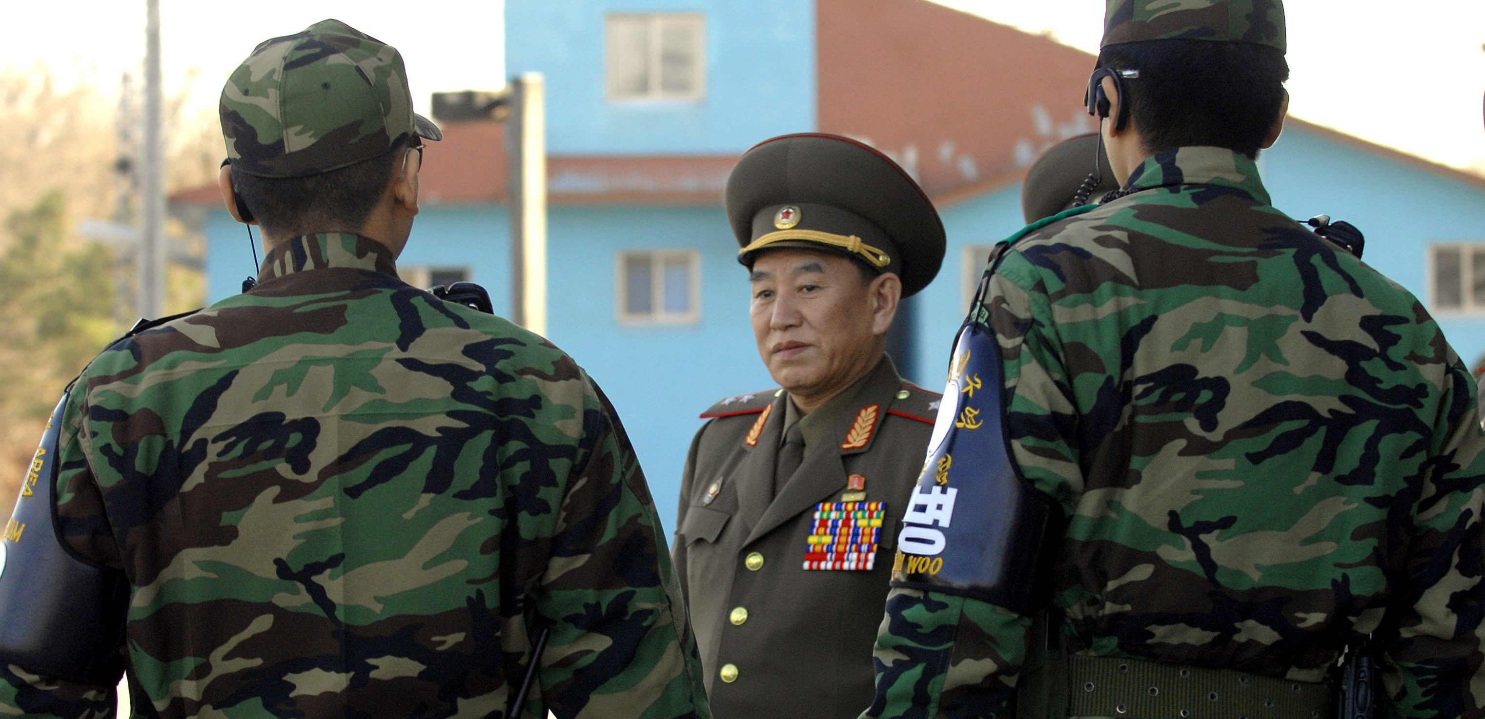 North Korea's chief delegate Kim walks by South Korean soldiers after the inter-Korean general talks at the south side of the truce village of Panmunjom
