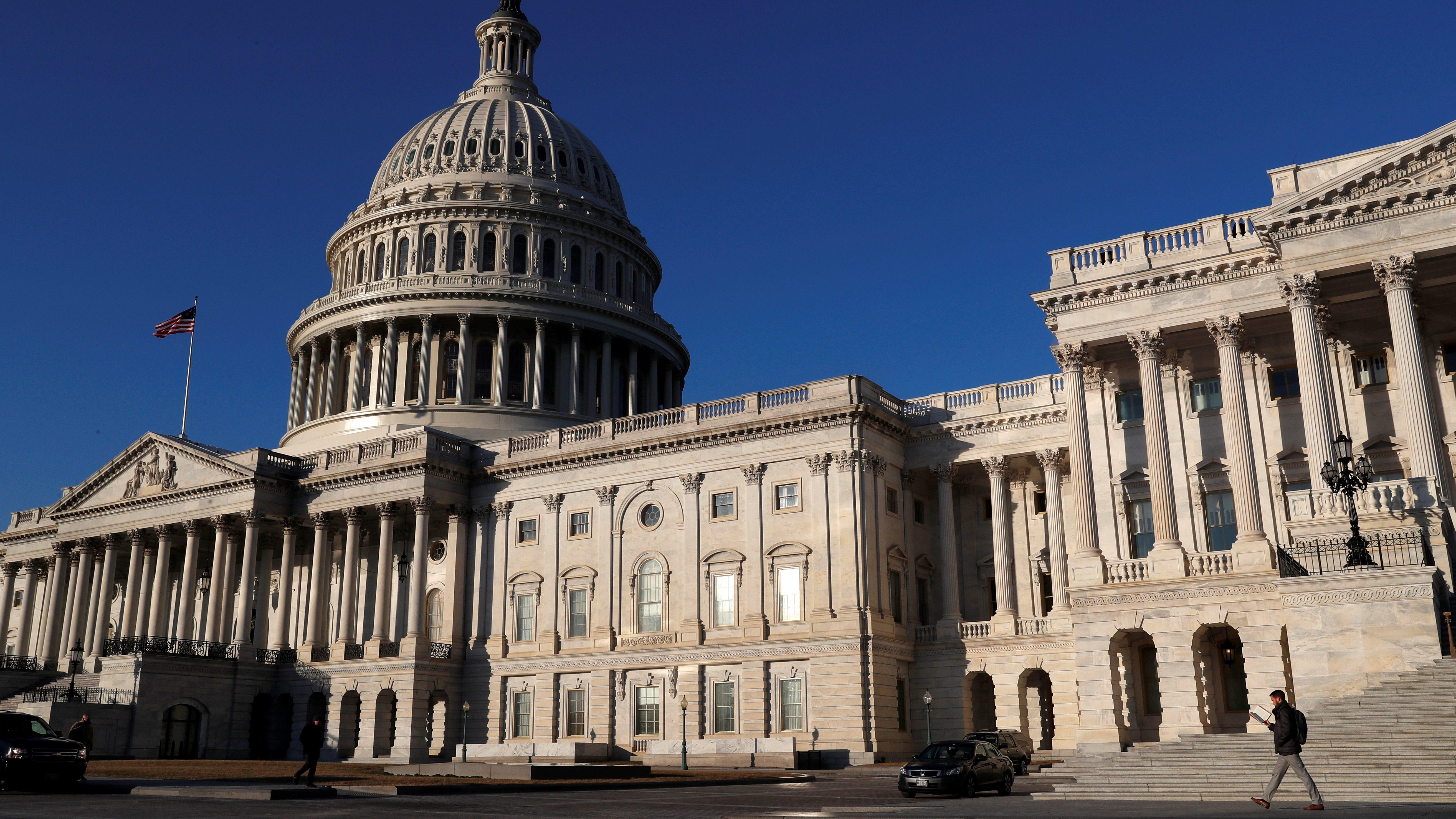 People walk by the U.S. Capitol building in Washington, U.S., February 8, 2018. REUTERS/ Leah Millis - RC13B8F2EB90