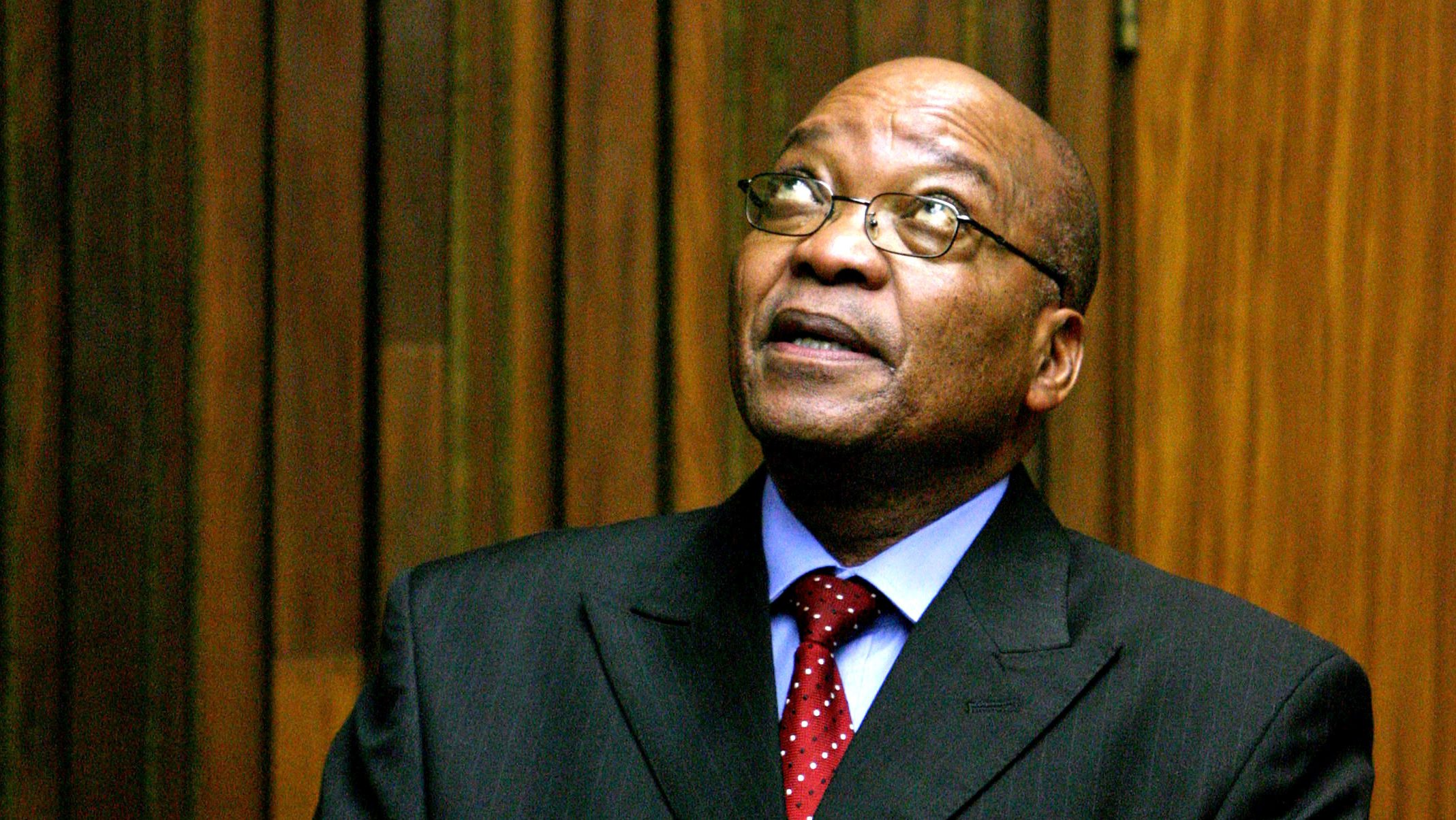 Former South African deputy-President Jacob Zuma stands in the dock during the judgement in his trial for rape in the Johannesburg High Court, May 8, 2006.