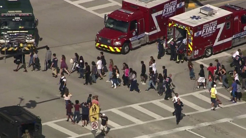 The familiar scene, this time after the shooting at Marjory Stoneman Douglas High School in Parkland, Florida.