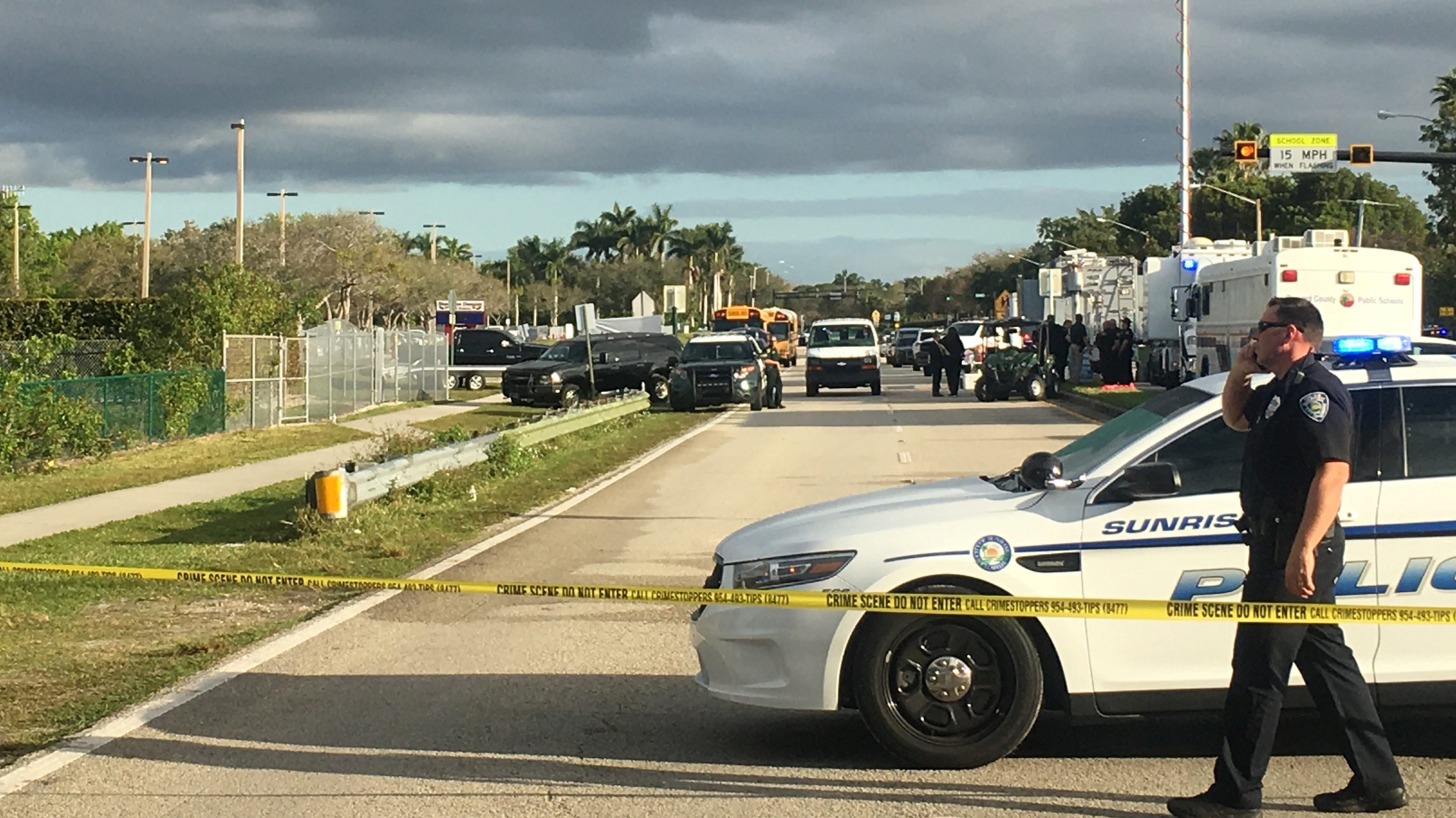 Police patrol the area outside Marjory Stoneman Douglas High School following a school shooting incident in Parkland, Florida, U.S., February 15, 2018.  REUTERS/Zachary Fagenson - RC13BDCCCF10