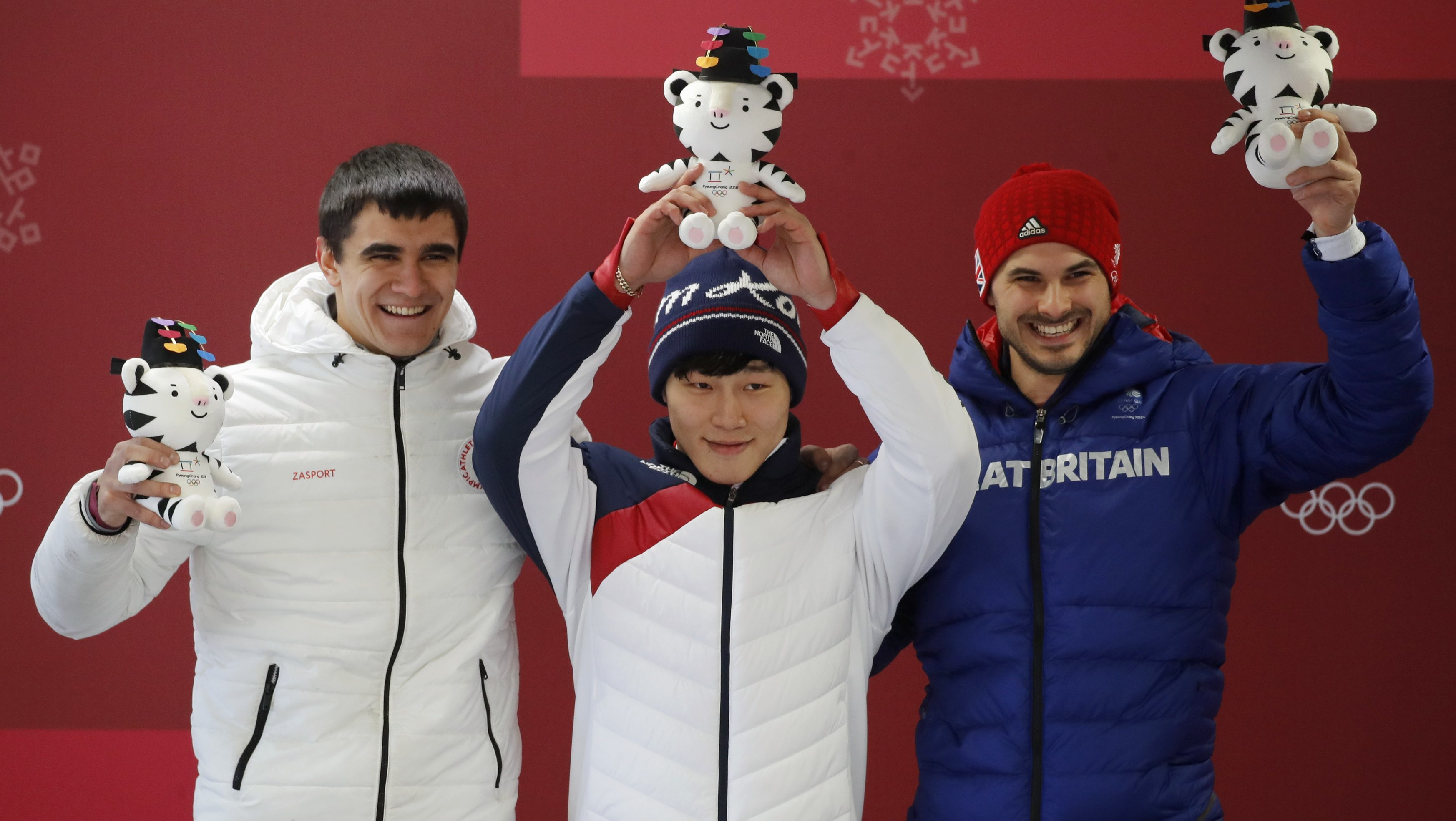 At the Pyeongchang 2018 Winter Olympics, men's skeleton gold medallist Yun Sung-bin of South Korea, silver medallist Nikita Tregubov, and bronze medallist Dom Parsons of Britain pose at the victory ceremony.