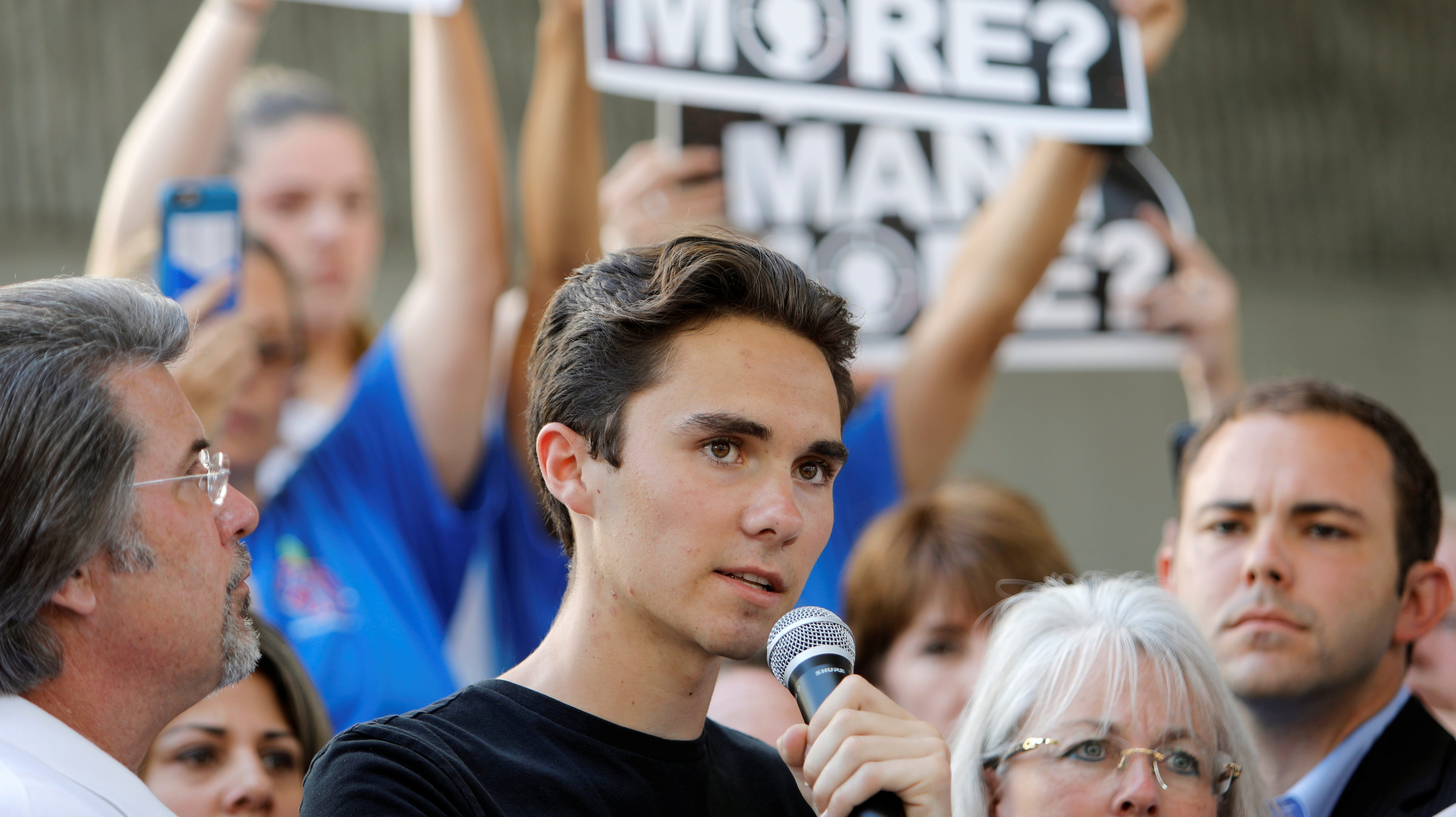 David Hogg, a senior at Marjory Stoneman Douglas High School, speaks at a rally calling for more gun control three days after the shooting at his school, in Fort Lauderdale, Florida, U.S. February 17, 2018.   REUTERS/Jonathan Drake - RC1CC98B4AB0
