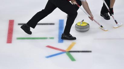Curling - Pyeongchang 2018 Winter Olympics - Men's Round Robin - Gangneung Curling Center - Gangneung, South Korea - February 19, 2018 - Curlers sweep during session 9 of the Men's Round Robin.
