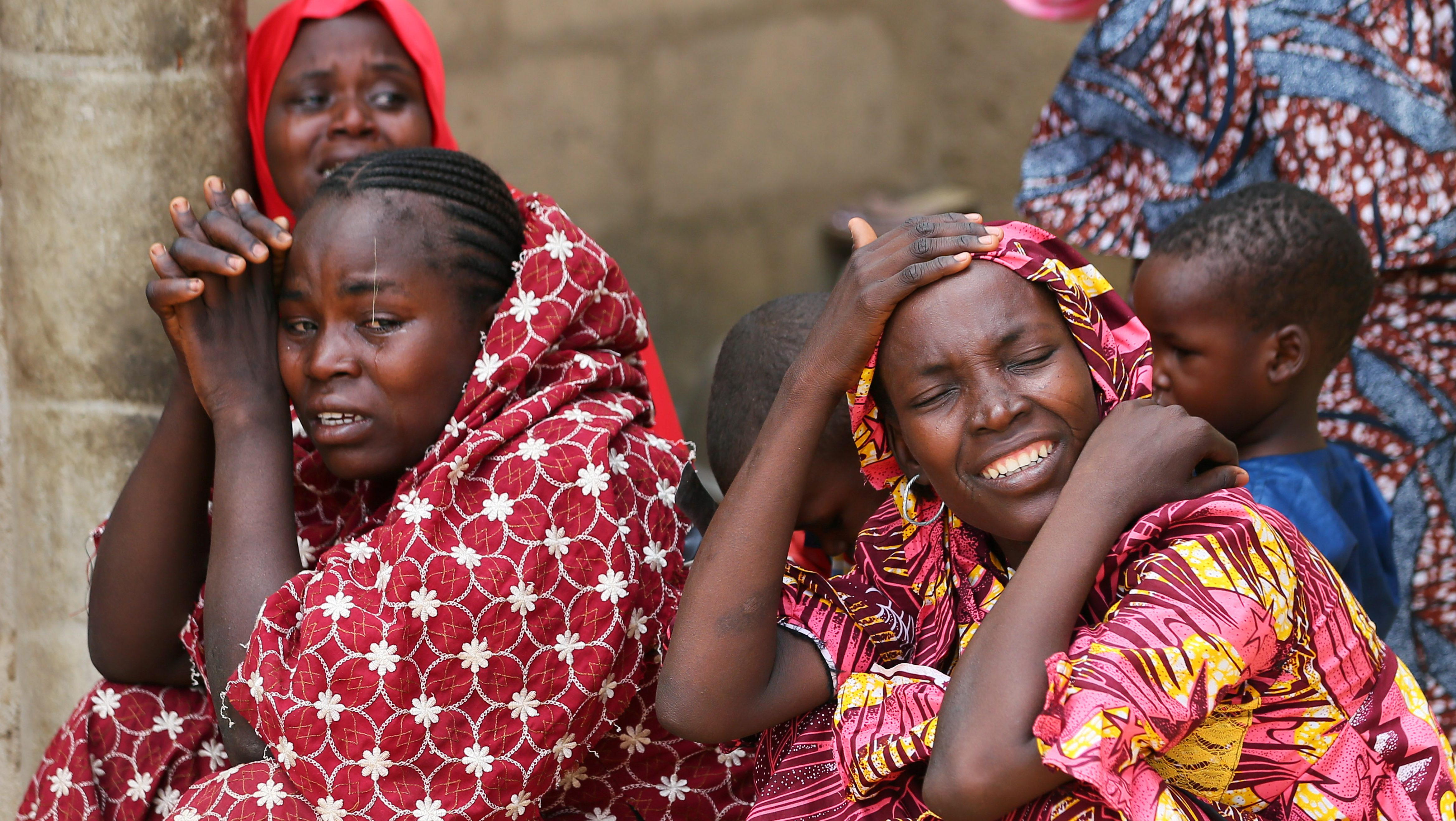 Relatives of missing school girls react in Dapchi in the northeastern state of Yobe