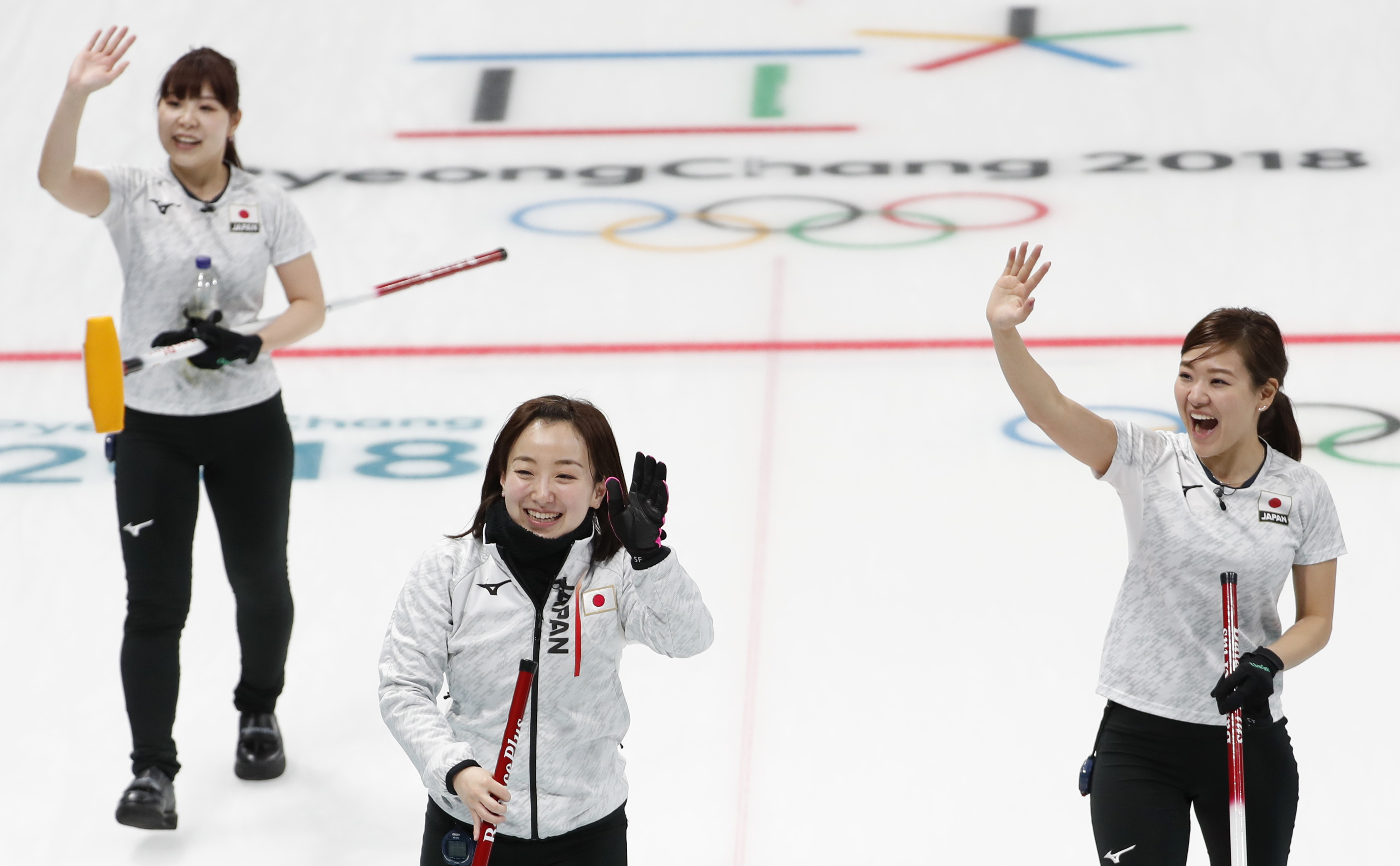 Curling - Pyeongchang 2018 Winter Olympics - Women Round Robin - Olympic Athletes from Russia v Japan - Gangneung Curling Center - Gangneung, South Korea - February 17, 2018 - Lead Yurika Yoshida, skip Satsuki Fujisawa and vice-skip Chinami Yoshida of Japan react after winning the game. REUTERS/Cathal McNaughton - DEVEE2H13H0BA