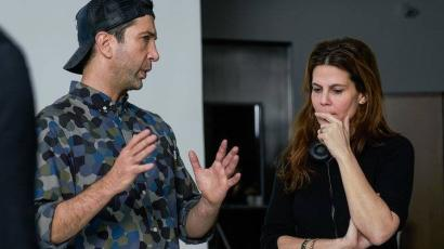 Schwimmer gestures as he talks to Sigal Avin