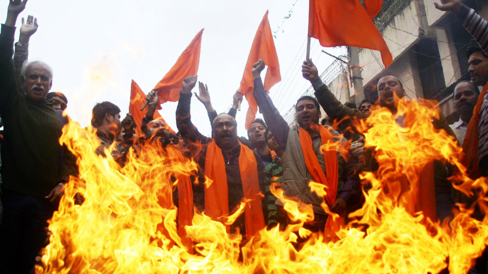 Hindu nationalist Shiv Sena activists burn an effigy representing Foreign Direct Investment (FDI) and shout slogans against the United Progressive Alliance (UPA) government during protest in the northern Indian city of Jammu, the winter capital of Kashmir on 01 December 2011. According to reports many political party and traders in India are observing a day-long strike in protest at the decision by the central government's decision to allow Foreign Direct Investment (FDI) in retail sector to global supermarket chains.