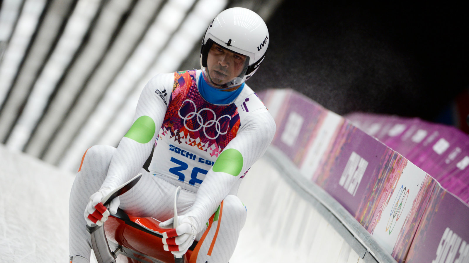 Shiva Keshavan of India starting as an Independent Olympic Athlete (IOP) arrives to the finish in his second run in the men's singles Luge at the Sanki Sliding Center at the Sochi 2014 Olympic Games, Krasnaya Polyana, Russia, 09 February 2014.
