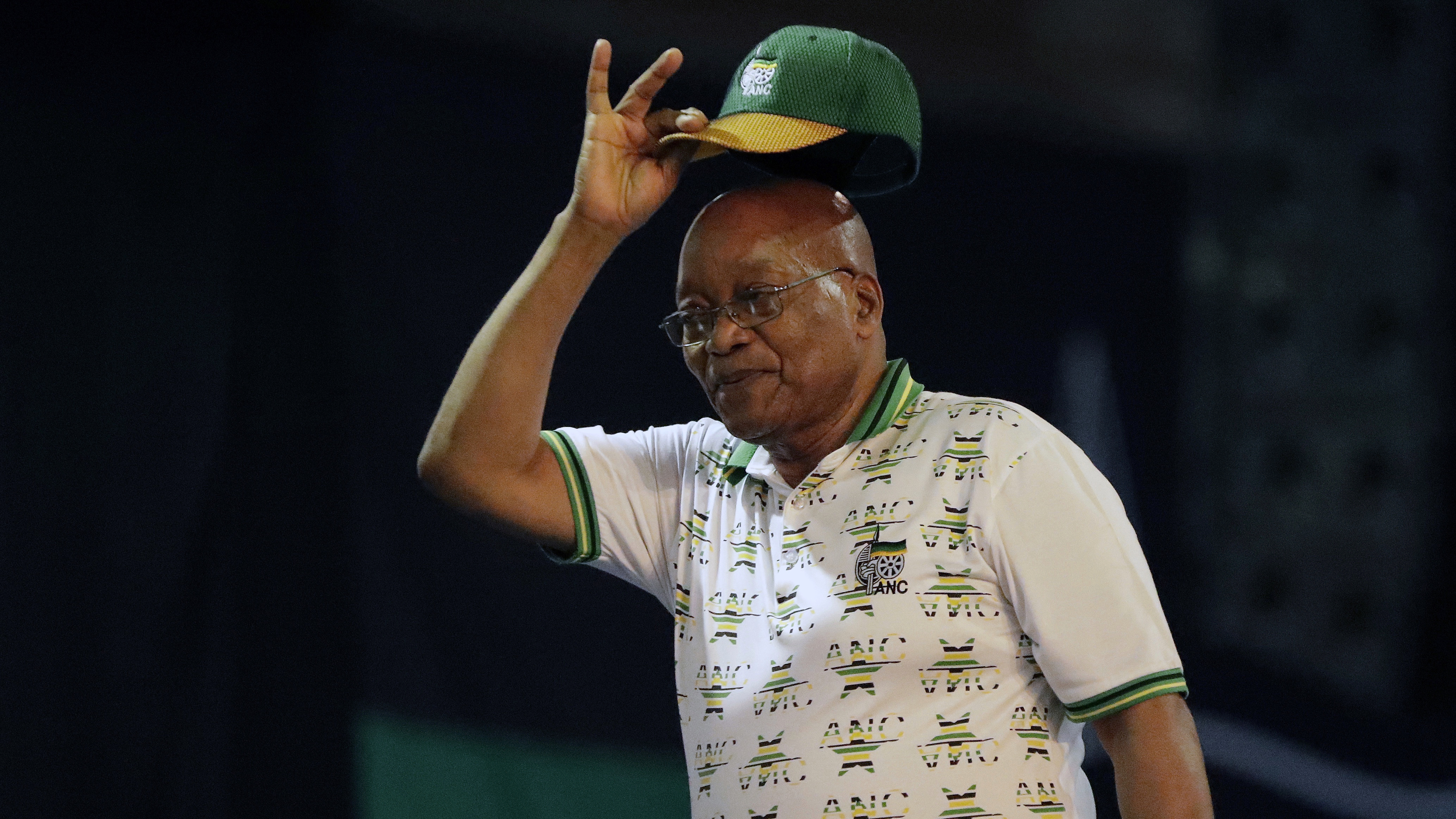 Outgoing ANC president and South African President Jacob Zuma, raises his cap after the newly elected African National Congress (ANC) President, Cyril Ramaphosa,  after it was announced that he had won the vote at the ANC's elective conference in Johannesburg, Monday Dec. 18, 2017. Outgoing Zuma's second and final term as party leader has ended after a scandal-ridden tenure that has seen a plummet in the popularity of Nelson Mandela's liberation movement. (AP Photo/Themba Hadebe)