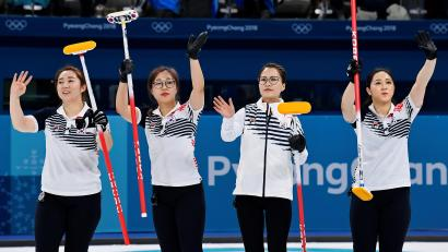 Curling - Pyeongchang 2018 Winter Olympics - Women's Round Robin - Sweden v South Korea - Gangneung Curling Center - Gangneung, South Korea - February 19, 2018 - Kim Eun-jung, Kim Kyeong-ae, Kim Seon-yeong and Kim Yeong-mi of South Korea celebrate beating Sweden. REUTERS/Toby Melville/File Photo - RC12DB767A60