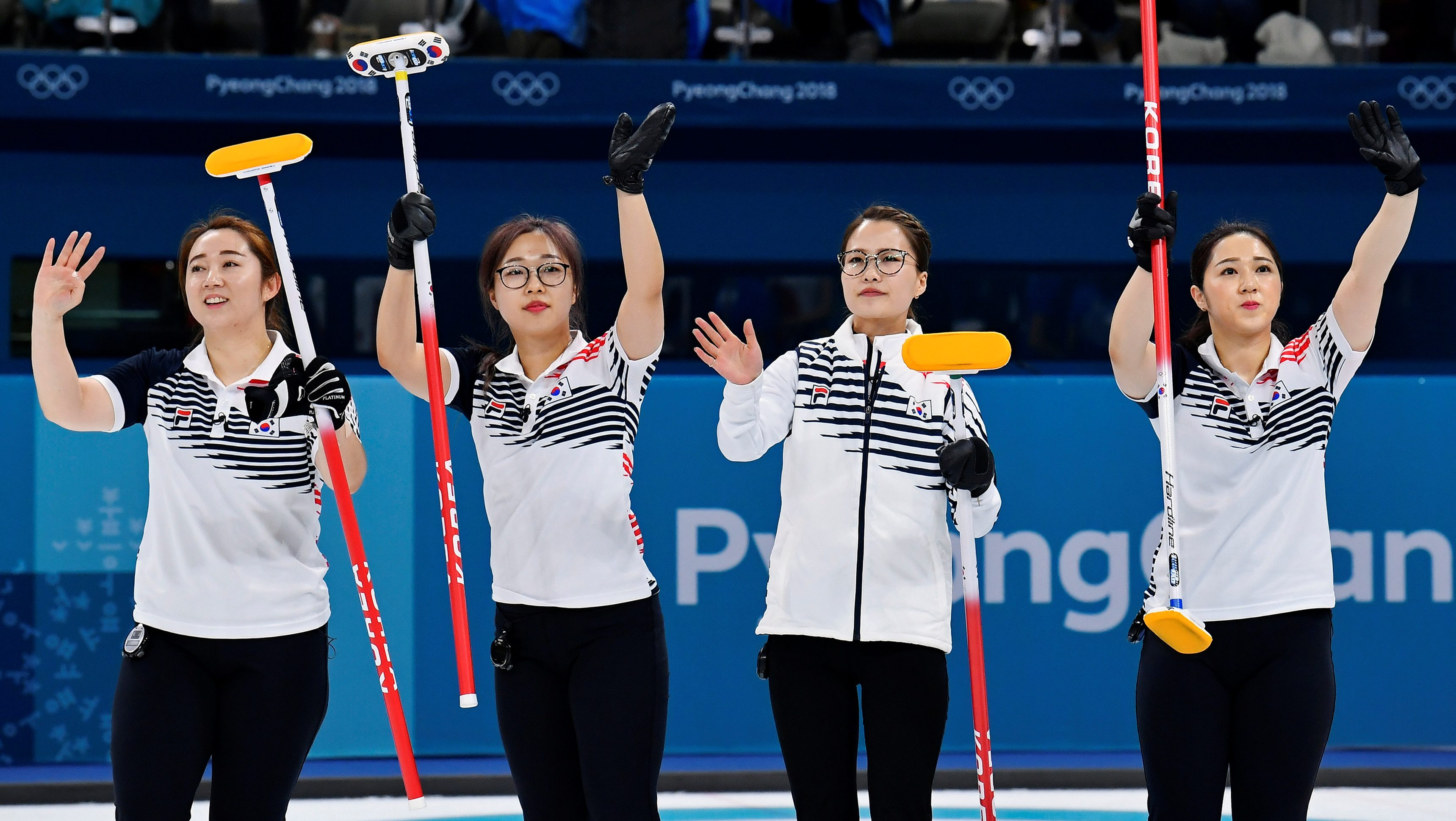 Curling - Pyeongchang 2018 Winter Olympics - Women's Round Robin - Sweden v South Korea - Gangneung Curling Center - Gangneung, South Korea - February 19, 2018 - Kim Eun-jung, Kim Kyeong-ae, Kim Seon-yeong and Kim Yeong-mi of South Korea celebrate beating Sweden. REUTERS/Toby Melville