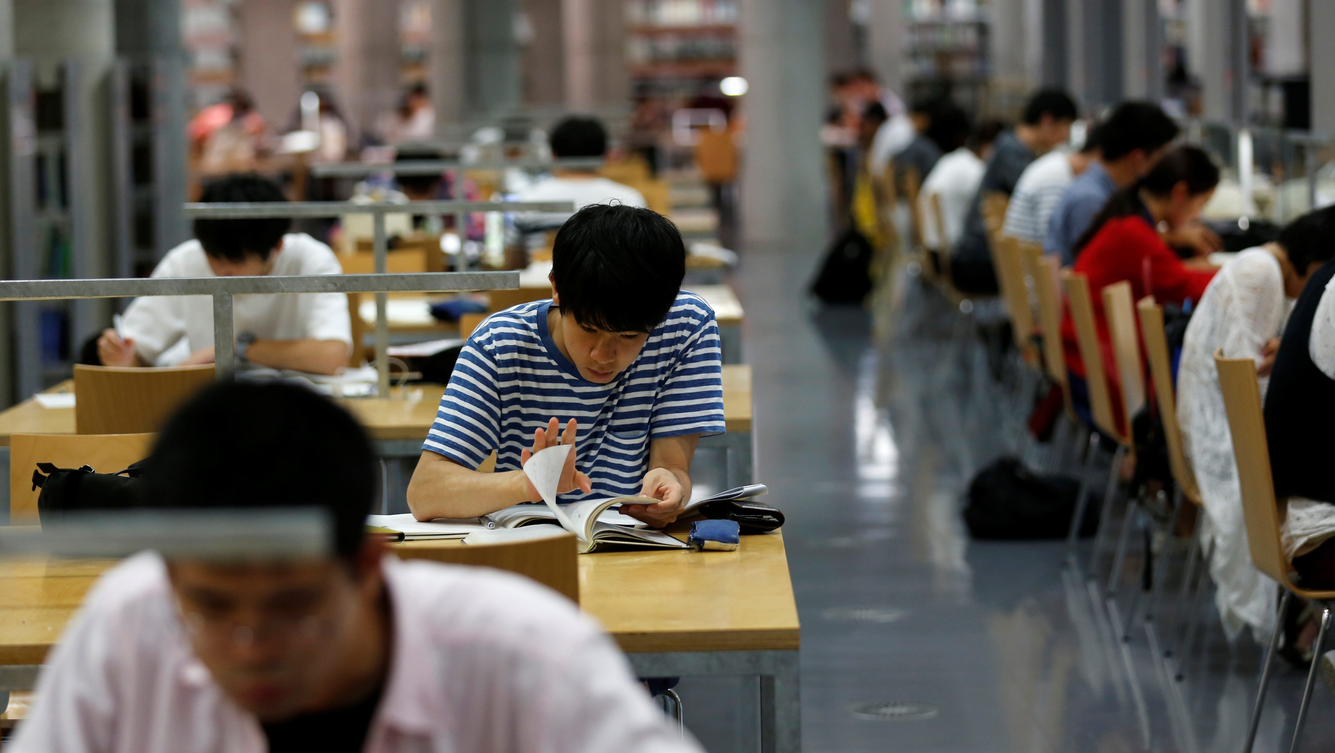 Students study in the Institute Library at Tokyo Institute of Technology in Tokyo, Japan July 14, 2016.