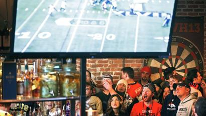 Denver Broncos fans react to a play while watching their team's NFL Super Bowl XLVIII football game against the Seattle Seahawks at the View House bar in Denver, Colorado February 2, 2014.
