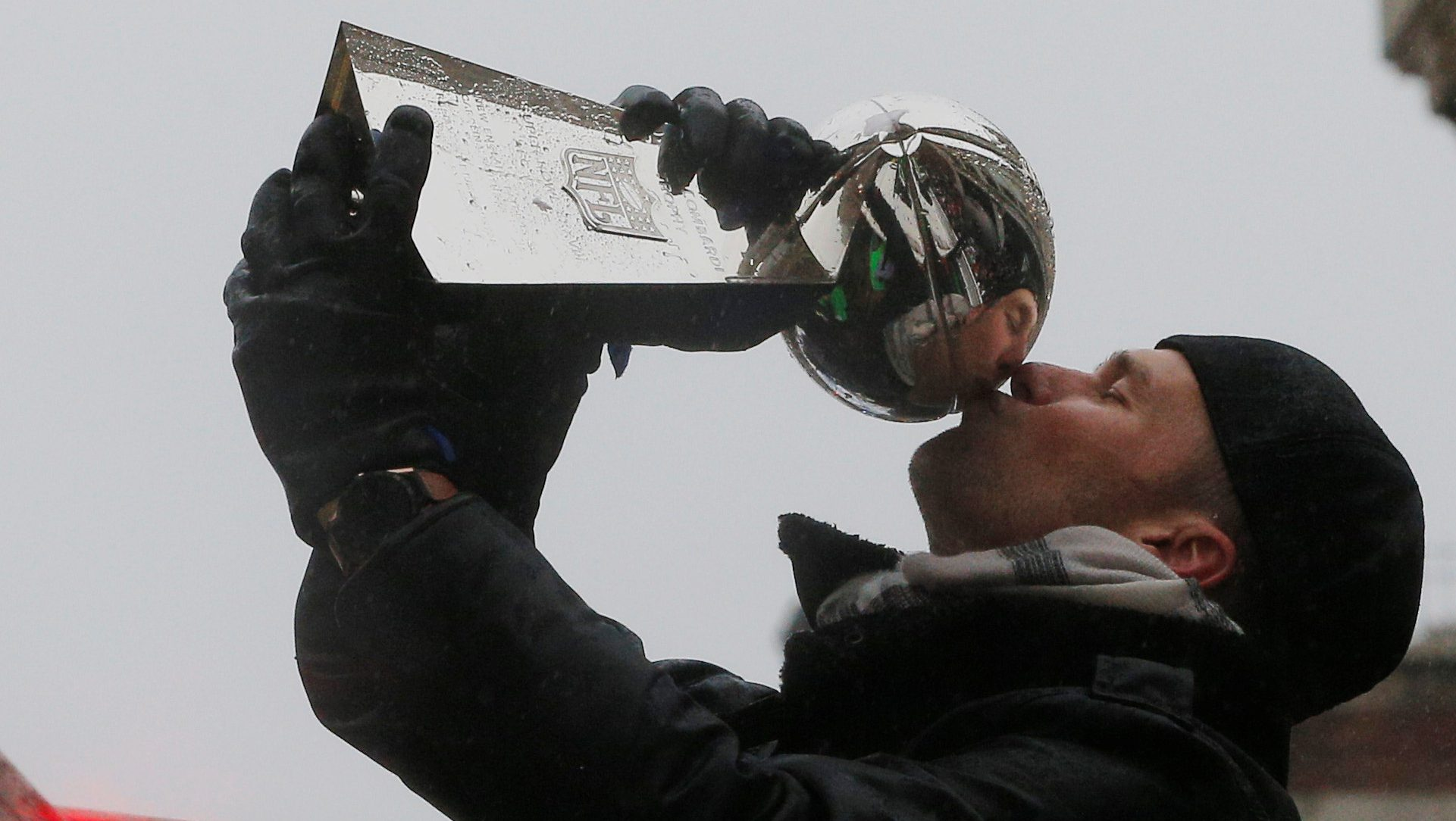 New England Patriots quarterback Tom Brady kisses one of the team's five Vince Lombardi trophies during their victory parade through the streets of Boston after winning Super Bowl LI, in Boston, Massachusetts, U.S. February 7, 2017.