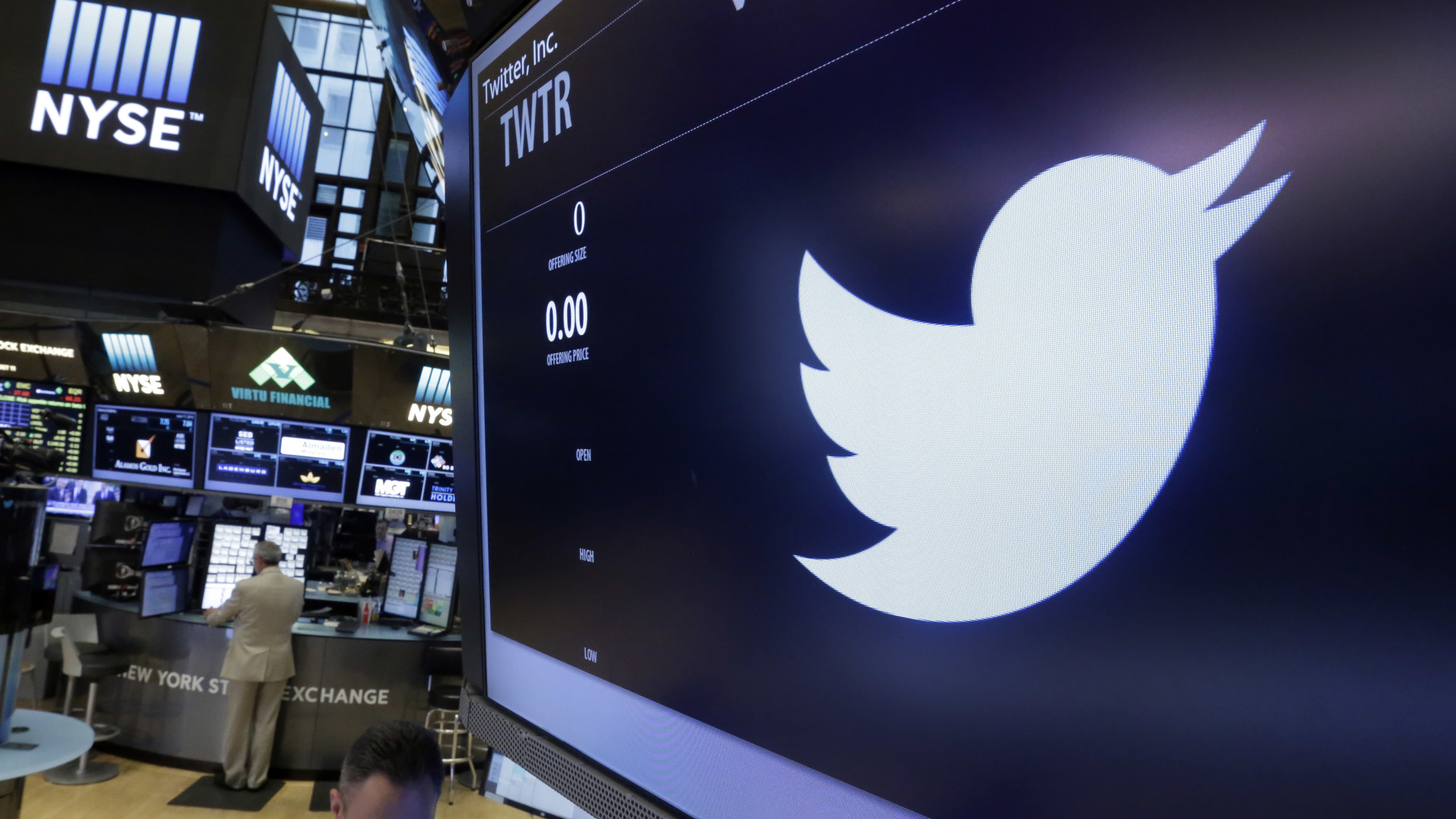 The Twitter logo appears at the post where it trades, on the floor of the New York Stock Exchange, Friday, June 17, 2016. (AP Photo/Richard Drew)