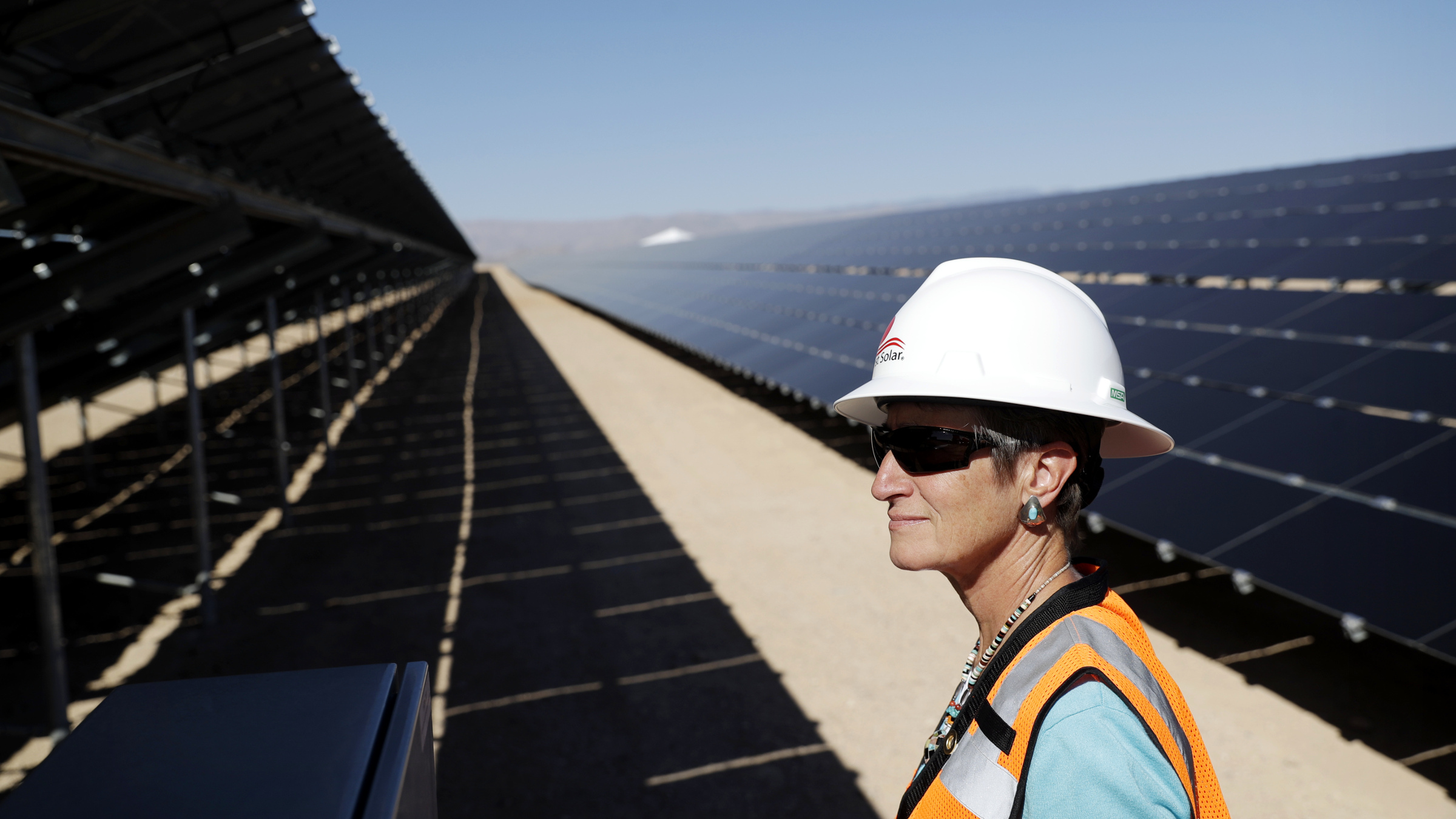 FILE - In this Sept. 15, 2016, file photo, then Secretary of the Interior Sally Jewell tours a solar project site on the Moapa River Indian Reservation about 40 miles northeast of Las Vegas. Elected officials and tribal leaders helped Friday, March 17, 2017, to power up the vast sun-to-electricity array that, in 2012, was the first utility-scale power production plant approved by the U.S. Interior Department on Indian land nationwide.