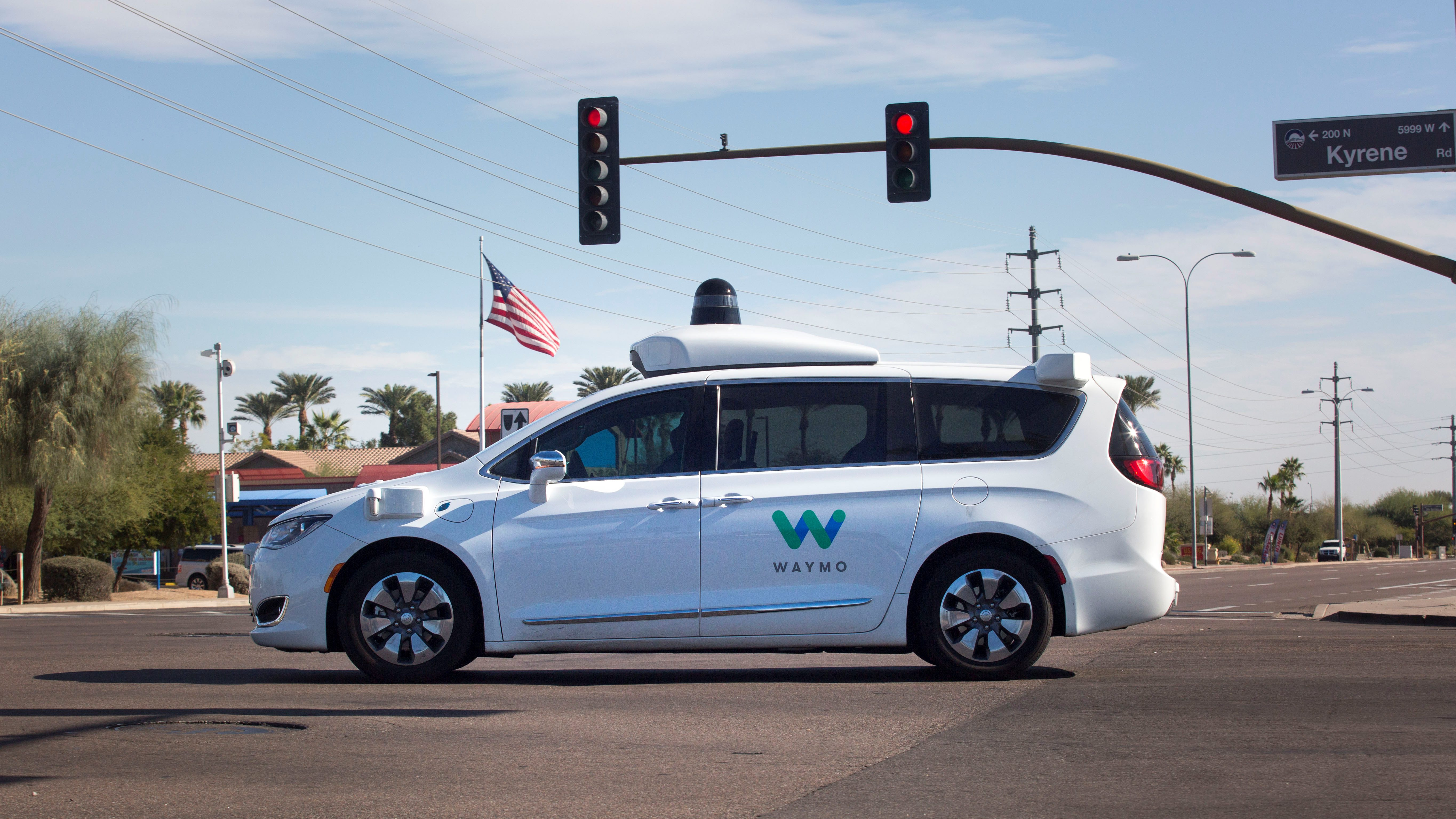 A Waymo self-driving vehicle moves through an intersection in Chandler Arizona