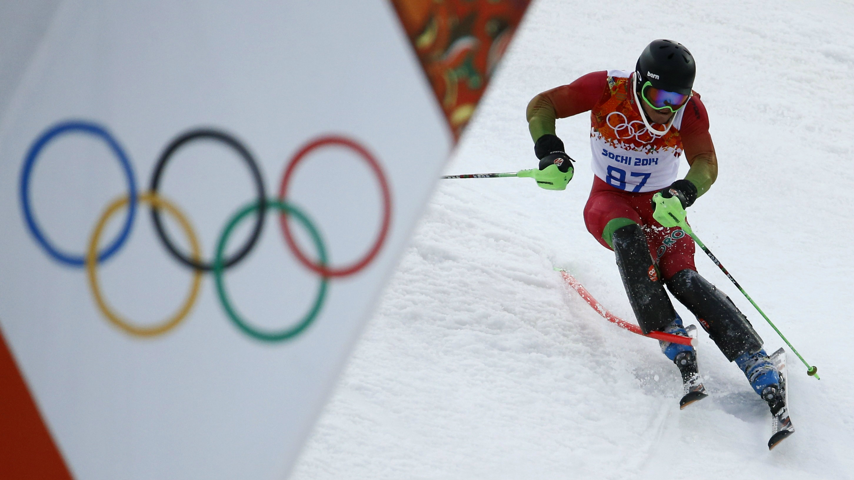 Morocco's Adam Lamhamedi clears a pole as he competes in the first run of the men's alpine skiing slalom event during the 2014 Sochi Winter Olympics at the Rosa Khutor Alpine Center February 22, 2014