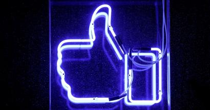 a neon facebook like thumbs-up button