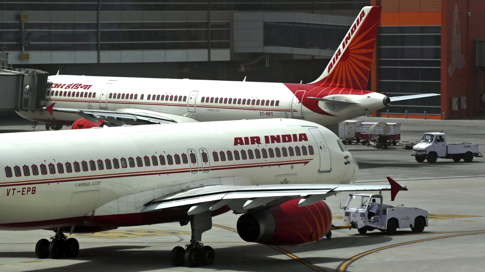 """In this May 18, 2012, file photo, Air India planes are parked on the tarmac at the Terminal 3 of Indira Gandhi International Airport in New Delhi, India. India's federal cabinet has approved a plan to privatise its debt-ridden national carrier Air India. A statement from the finance ministry Wednesday, June 28, 2017, said that the government had given """"in principle"""" approval to sell disinvest from the troubled airline which has struggled to emerge from the red as competition from a number of low-cost airlines has grown."""