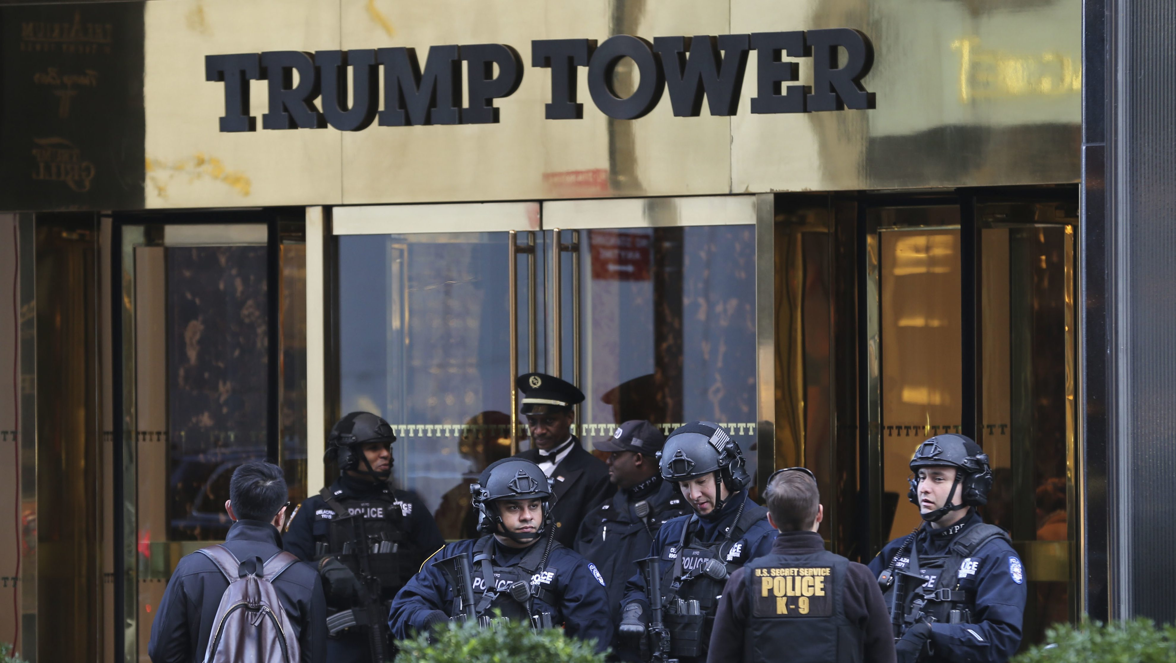 """FILE - In this Nov. 17, 2016 file photo, security personnel stand at the front entrance of Trump Tower in New York. There is no indication that Trump Tower was """"the subject of surveillance"""" by the U.S. government before or after the 2016 election, the top two members of the Senate intelligence committee said Thursday, March 16, 2017, directly contradicting President Donald Trump's claims.""""Based on the information available to us, we see no indications that Trump Tower was the subject of surveillance by any element of the United States government either before or after Election Day 2016,"""" Sens. Richard Burr, R-N.C. and Mark Warner, D-Va., said in a one-sentence joint statement Thursday afternoon. (AP Photo/Seth Wenig, File)"""