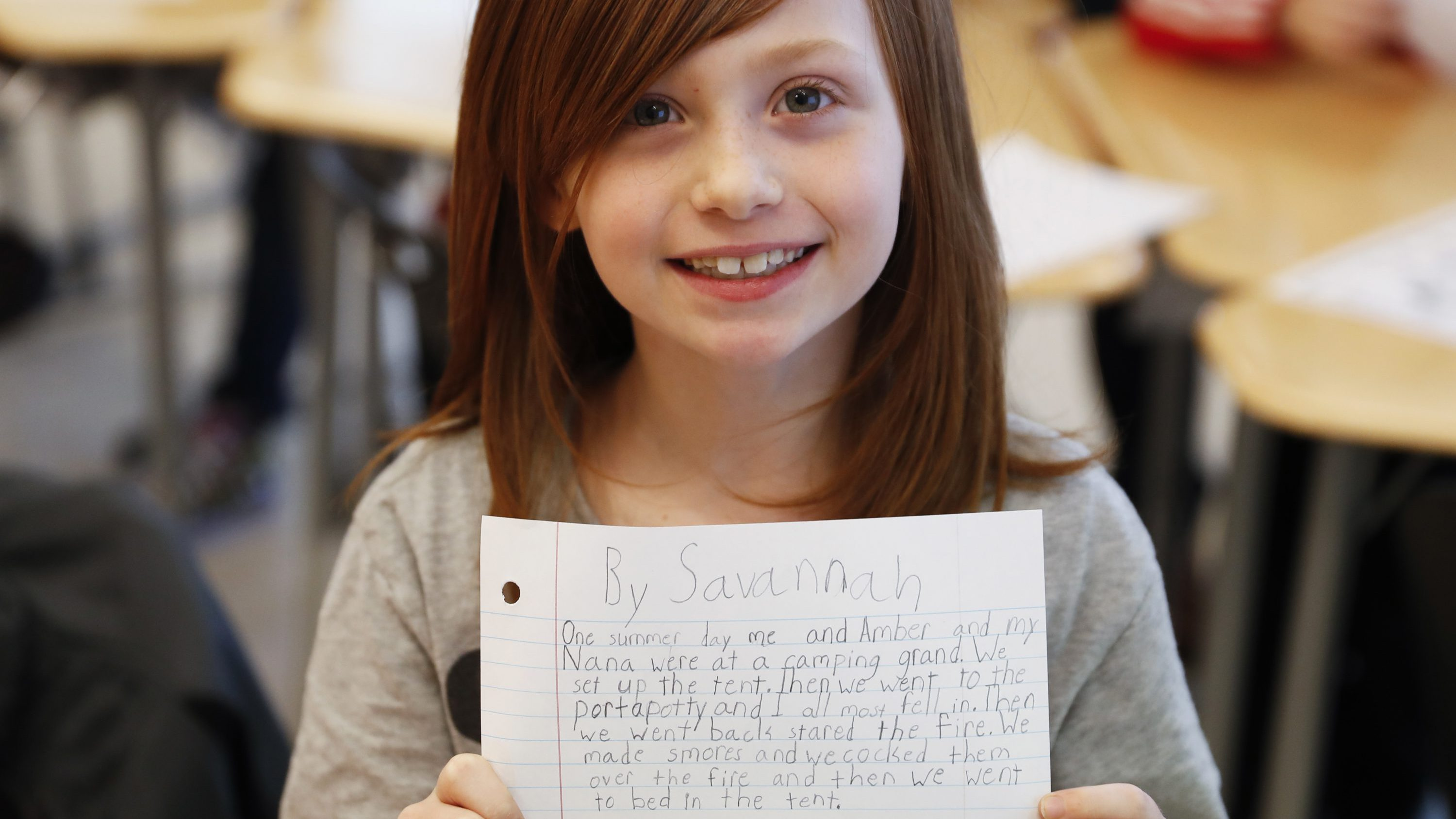 A student holds up her unfinished homework during an after-school program at Circleville Elementary School, Wednesday, March 29, 2017, in Circleville, Ohio. Circleville school officials said it would be very difficult to keep their after-school programs going if federal funding for the 21st Century Community Learning Centers program is eliminated as proposed by President Donald Trump's administration.