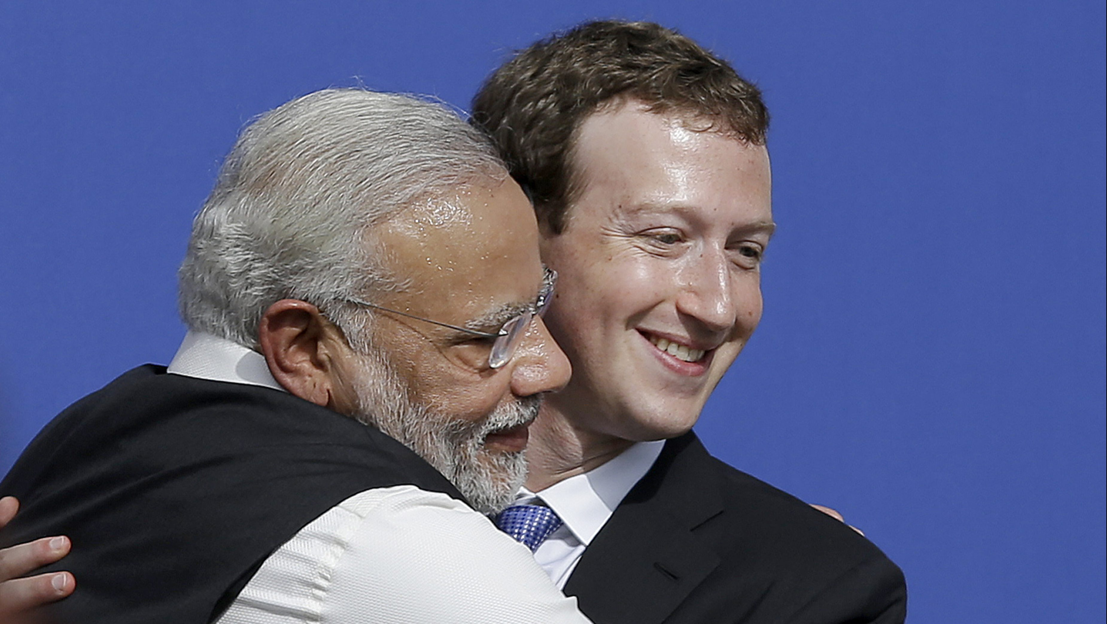 FILE - In this Sept. 27, 2015, file photo, Facebook CEO Mark Zuckerberg, right, hugs Prime Minister of India Narendra Modi at Facebook in Menlo Park, Calif. U.S. President Donald Trump should have been ready for a bear hug from Narendra Modi this week in Washington. The folksy embrace has become a signature move for the Indian prime minister in greeting global leaders and celebrities alike. (AP Photo/Jeff Chiu, File)
