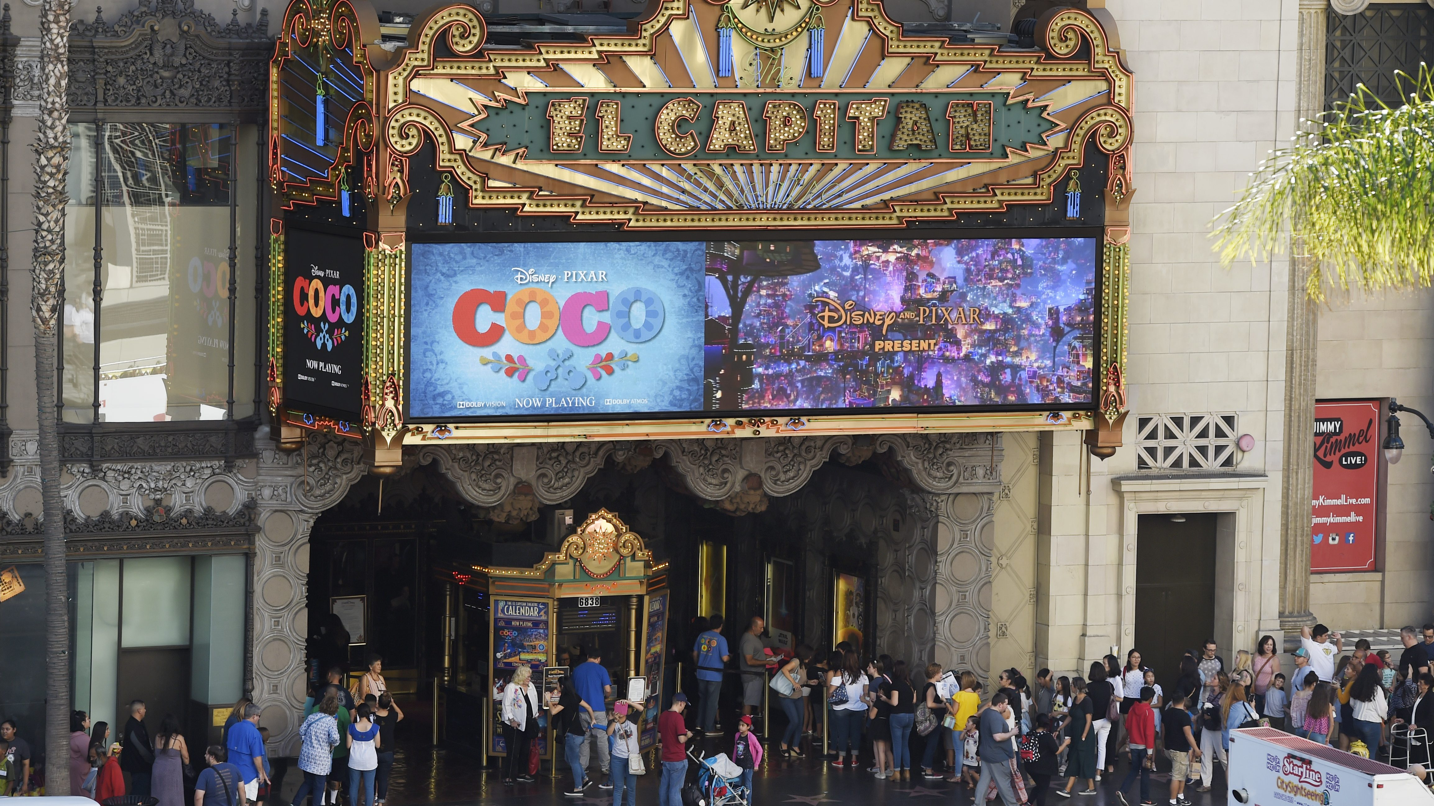 """HOLD FOR STORY -- Crowds line up at the El Capitan Theatre on Hollywood Boulevard for a screening of the Disney Pixar film """"Coco"""" on Wednesday, Nov. 22, 2017, in Los Angeles. (AP Photo/Chris Pizzello)"""
