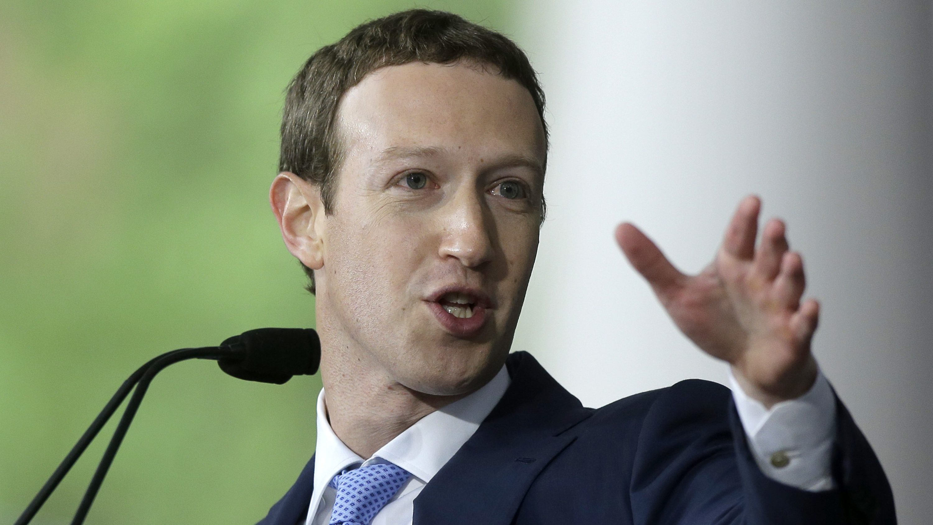 """In this May 25, 2017, file photo, Facebook CEO Mark Zuckerberg delivers the commencement address at Harvard University in Cambridge, Mass. Zuckerberg says his """"personal challenge"""" for 2018 is to fix Facebook. Zuckerberg wrote in a post Thursday, Jan. 4, 2018, that he now wants to focus on protecting Facebook users from abuse, defending against interference by nation-states and """"making sure that time spent on Facebook is time well spent."""""""