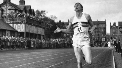 British Athlete Roger Bannister breaks the tape to become the first man ever to break the four minute mile May 6, 1954 at Iffly Field, Oxford, England. (AP Photo)