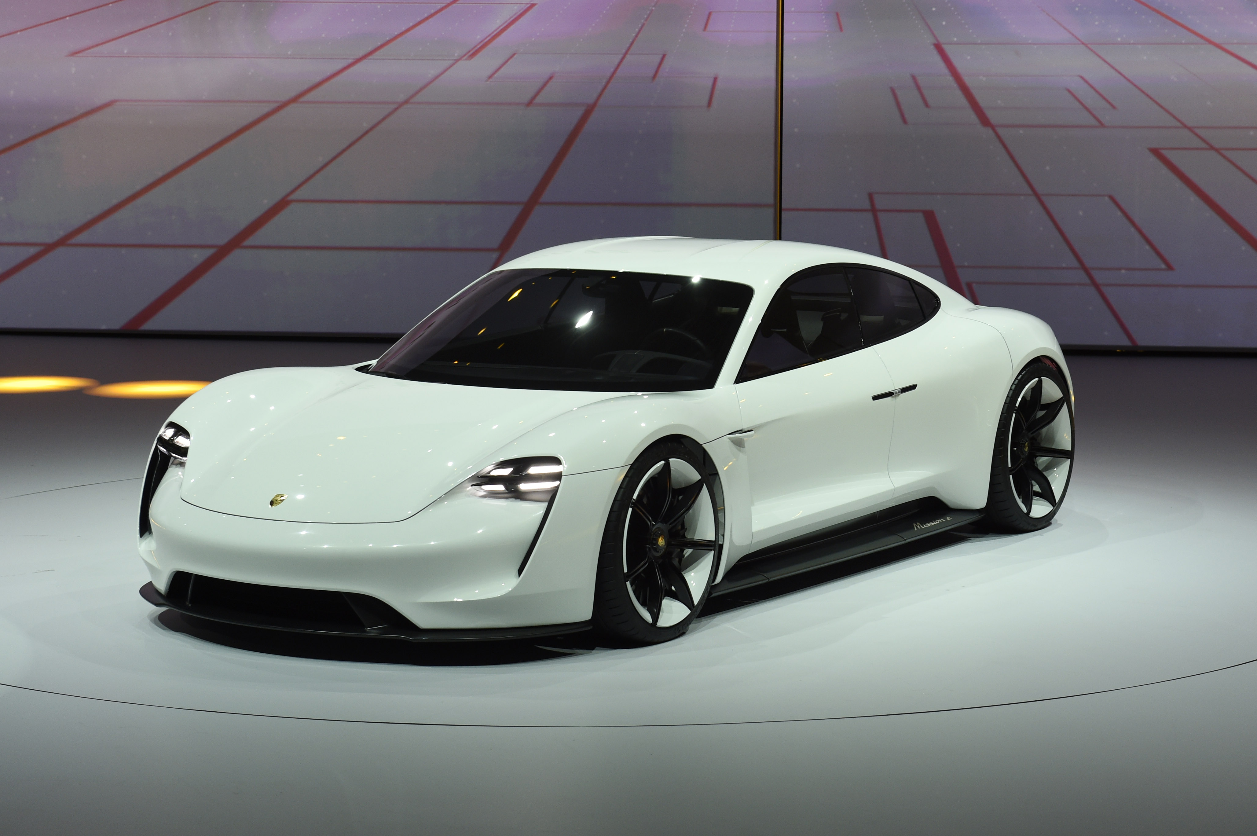 A Porsche Mission E is presented during the Volkswagen group night on the eve of the Frankfurt Auto Show IAA in Frankfurt, Germany, Monday, Sept. 14, 2015. (AP Photo/Jens Meyer)