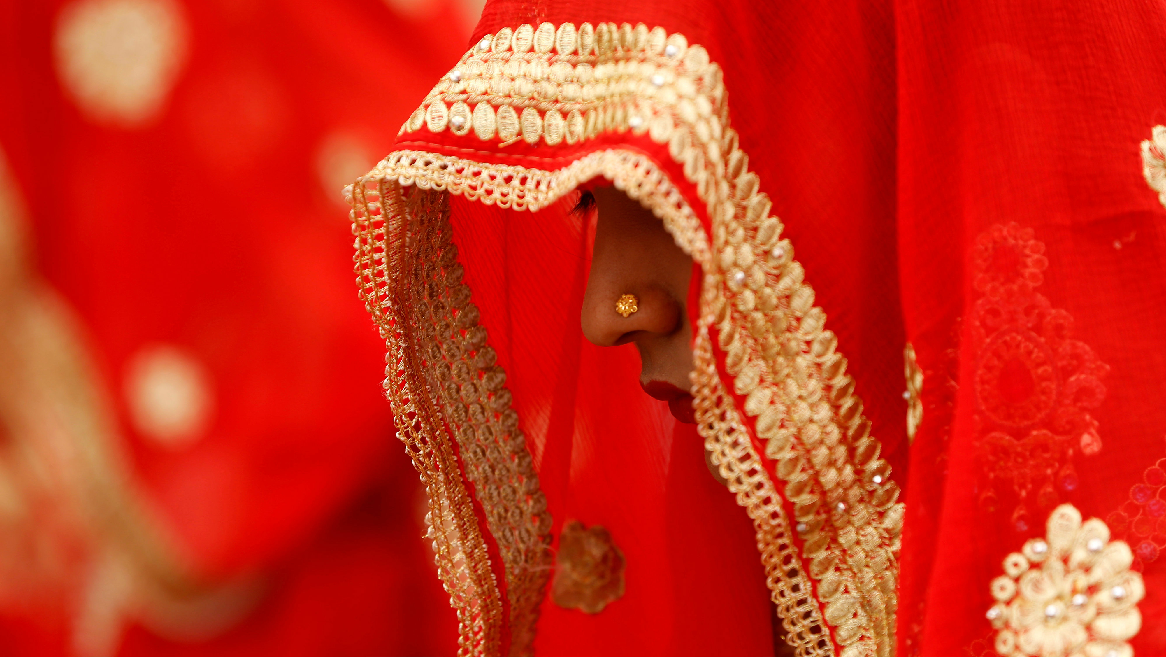 A bride waits to take her wedding vows during a Muslim marriage ceremony.