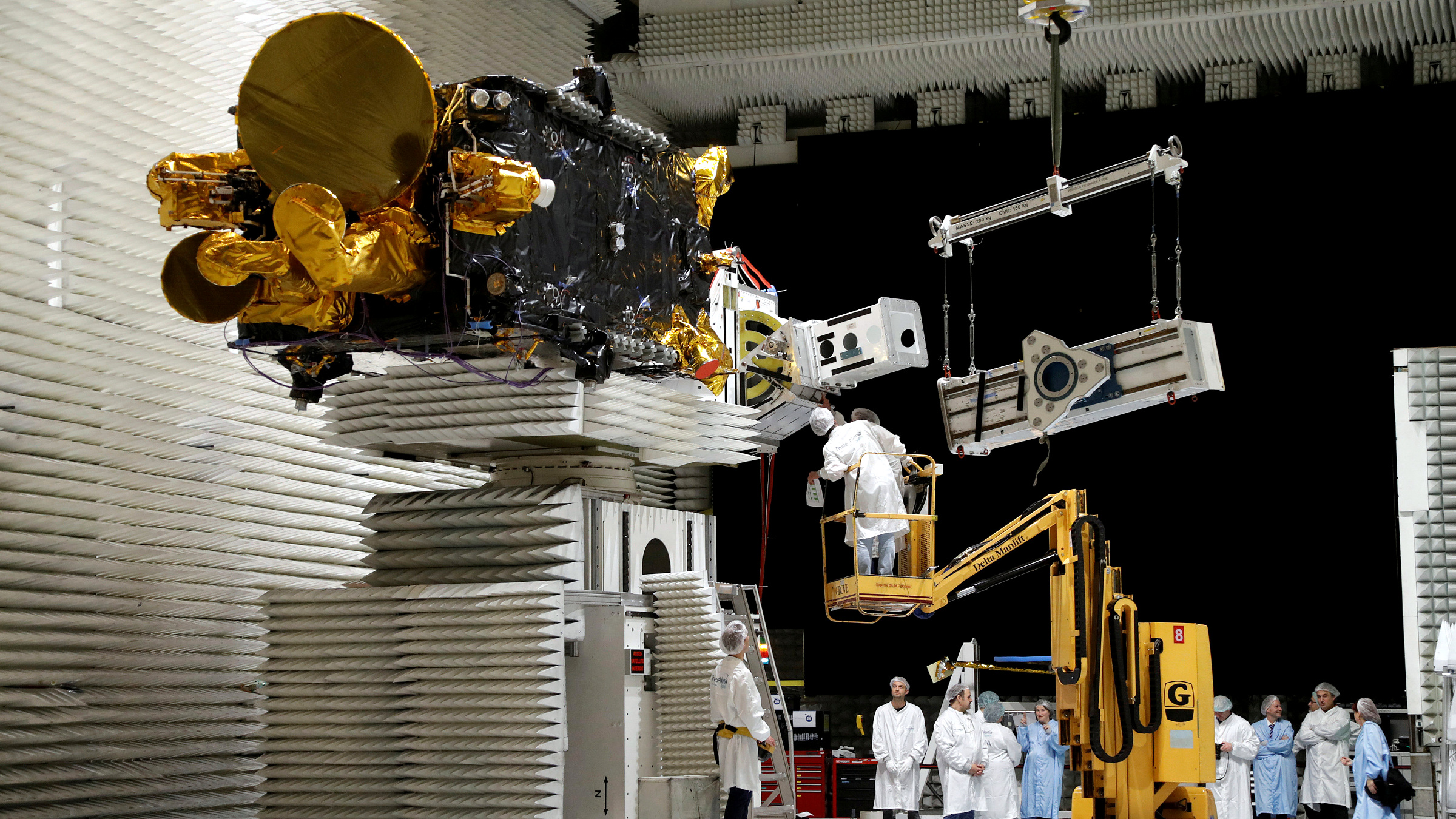 Technicians work on the Korean satellite Koreasat 5A in the clean room facilities of the Thales Alenia Space plant in Cannes, France, February 3, 2017.