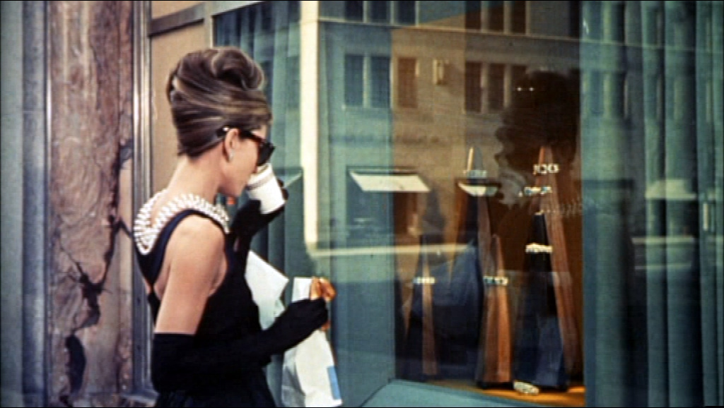 Audrey Hepburn in the iconic Givenchy dress, having breakfast at Tiffany's.