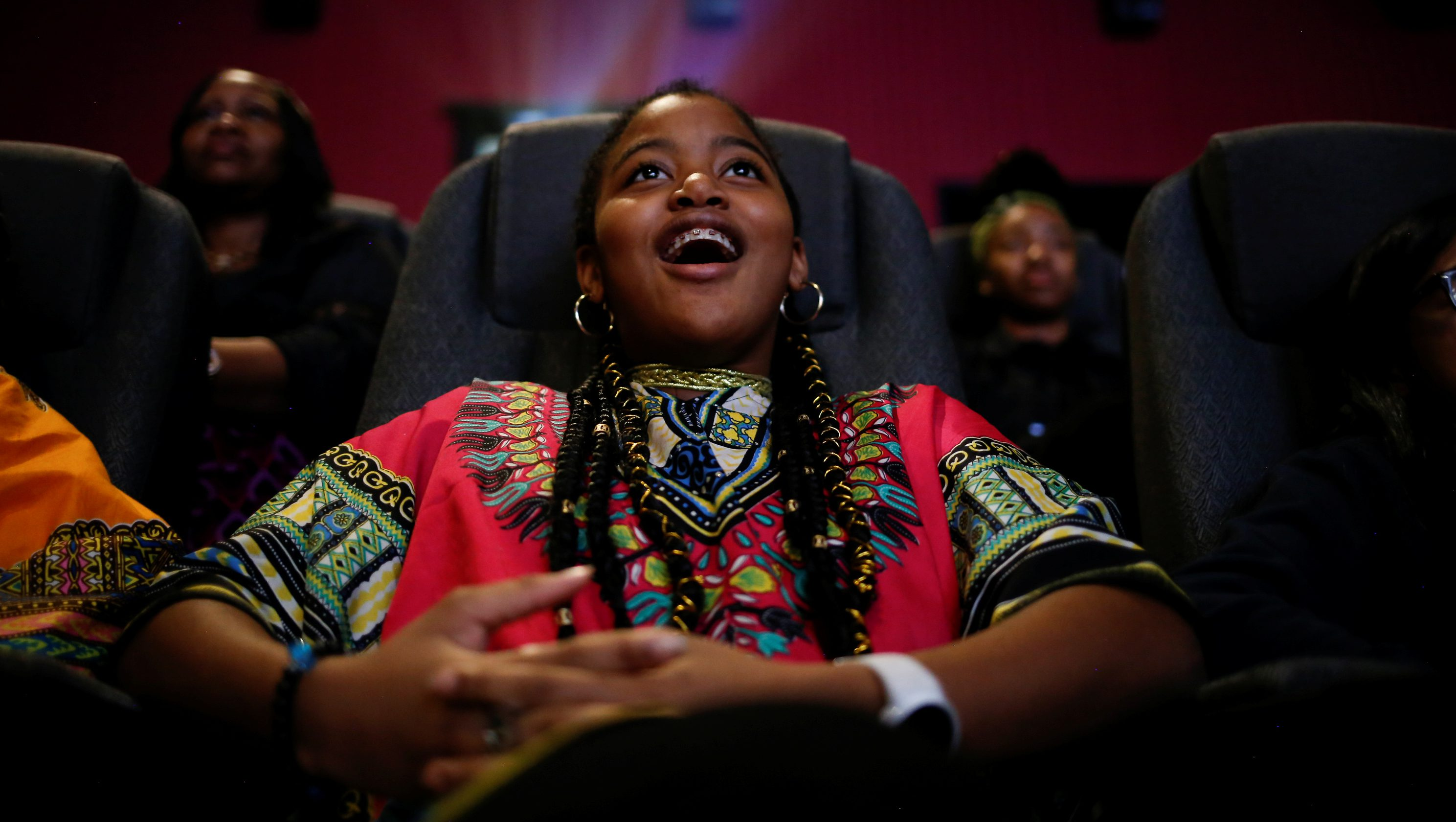 "Ron Clark Academy 6th grader De Ja Little, 12, joins classmates in watching the film ""Black Panther"" at Atlantic Station theaters in Atlanta, Georgia, U.S., February 21, 2018."