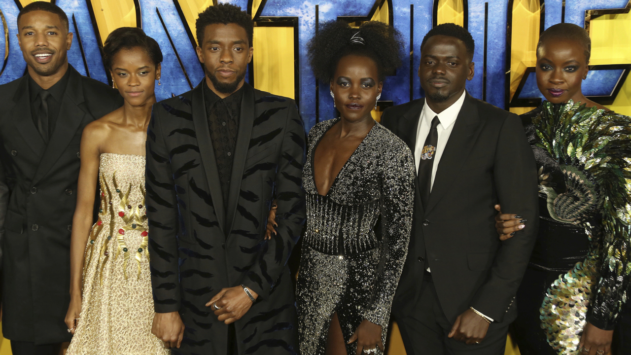 Actors Michael B. Jordan, Leitia Wright, Chadwick Boseman,  Lupita Nyong'o, Daniel Kaluuya and Danai Gurira pose for photographers upon arrival at the premiere of the film 'Black Panther' in London, Thursday, Feb. 8, 2018. (Photo by Joel C Ryan/Invision/AP)