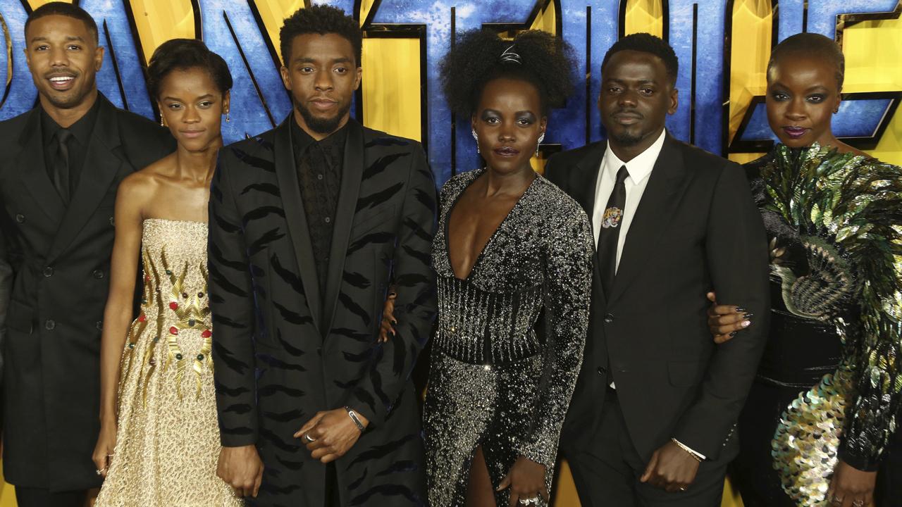 Actors Michael B. Jordan, Leitia Wright, Chadwick Boseman,  Lupita Nyong'o, Daniel Kaluuya and Danai Gurira pose for photographers upon arrival at the premiere of the film 'Black Panther' in London, Thursday, Feb. 8, 2018. (Photo by Joel C Ryan/Invision/AP)