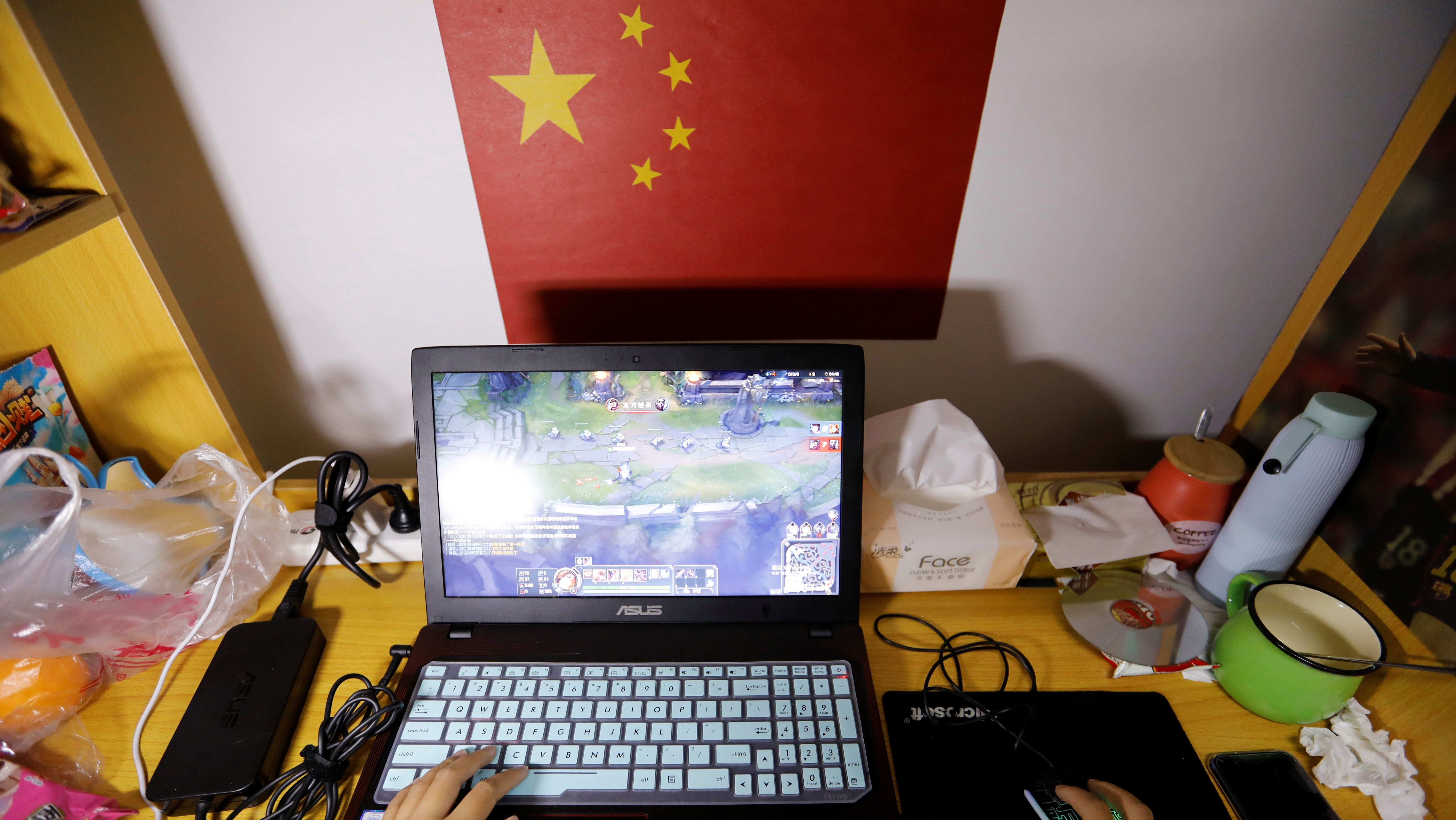 A student majoring esports and management practices on her laptop in a dormitory at the Sichuan Film and Television University in Chengdu, Sichuan province, China, November 19, 2017. The curriculum of the course is designed to prepare students for jobs in the growing industry that supports professional esports players who reach the peek of their career in their teenage years. The students study a wide range of subjects from commentating and script writing to event organising and gaming strategy. Picture taken November 19, 2017.