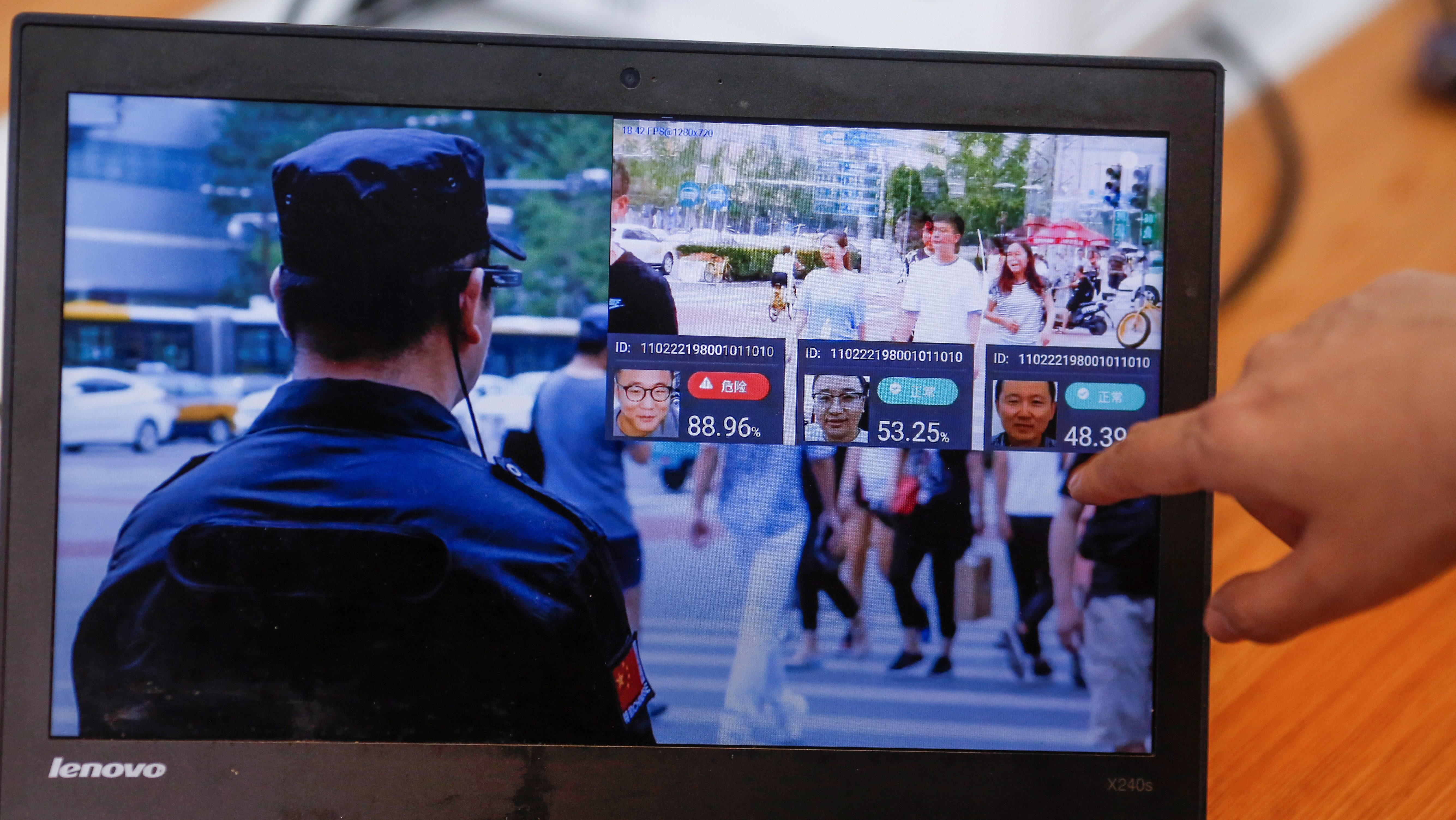 A promotion video shows an actor wearing LLVision facial recognition smart glasses during a demonstration at the company's office in Beijing, China February 28, 2018. Picture taken February 28, 2018.