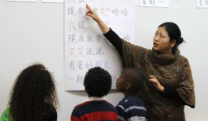 Teacher Kennis Wong (R) points to Chinese characters on a board at Broadway Elementary School in Venice, Los Angeles, California, April 11, 2011. The school launched one of only two English-Mandarin Chinese dual-language immersion programs in the Los Angeles Unified School District in September 2010.