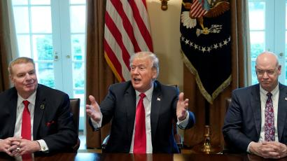 Chairman, CEO and president of Nucor John Ferriola and U.S. Steel CEO Dave Burritt flank U.S. President Donald Trump as he announces that the United States will impose tariffs of 25 percent on steel imports and 10 percent on imported aluminum during a meeting at the White House in Washington, U.S., March 1, 2018.