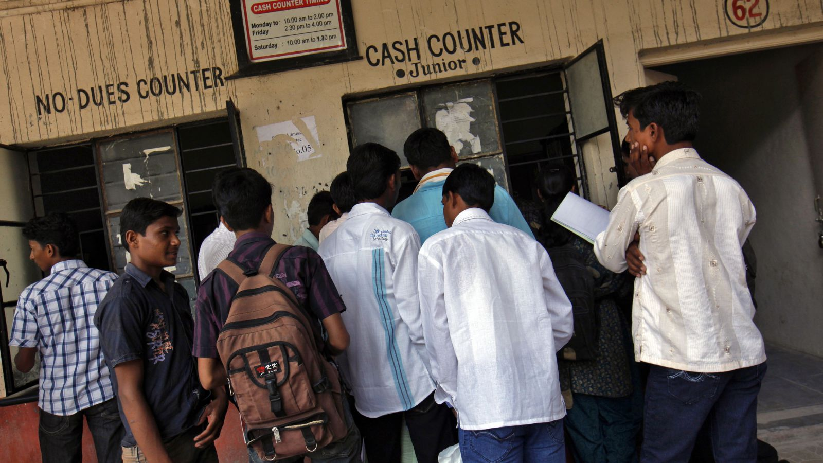 """Students submit their fees at the cash counter of the Balbhim College for Art, Science and Commerce in Beed, about 350 km (220 miles) east of Mumbai, June 28, 2012. India says the voice urging the 10 militants on to bloodshed during the assault on Mumbai in November 2008 was that of Indian-born Sayed Zabiuddin Ansari, who was speaking from a """"control room"""" in the Pakistani city of Karachi. New Delhi is hoping that Ansari's capture in June 2012 will help prove its allegation - strenuously denied in Islamabad - that the Mumbai carnage was directed by people connected with Pakistan's security establishment, particularly the shadowy ISI military intelligence agency. Ansari studied at Balbhim College. Picture taken June 28, 2012."""