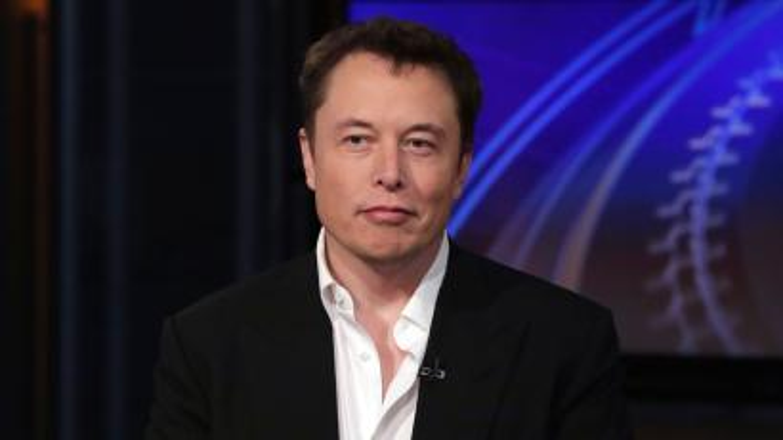 Elon Musk in a suit
