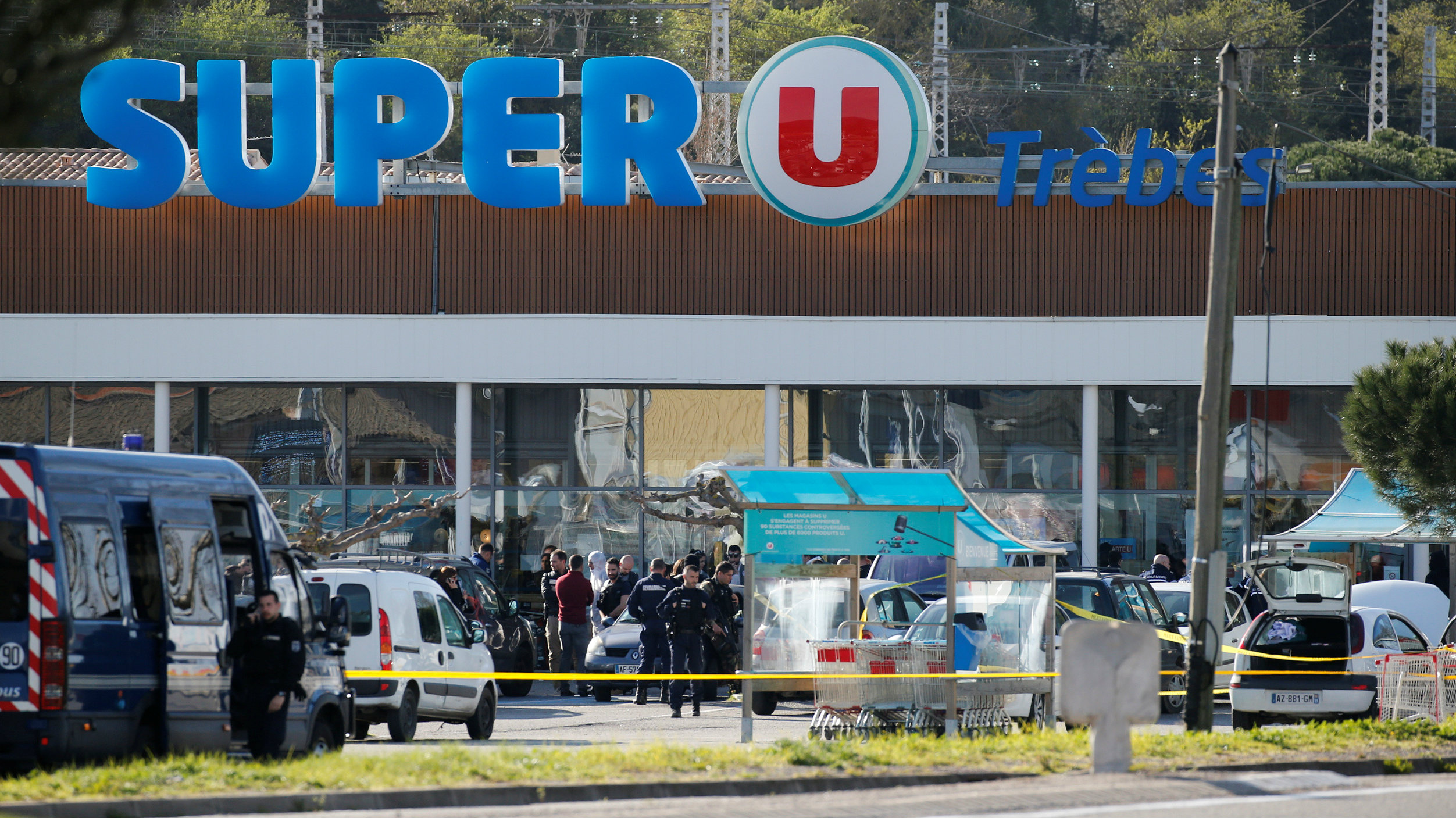 general view shows gendarmes and police officers at a supermarket after a hostage situation.