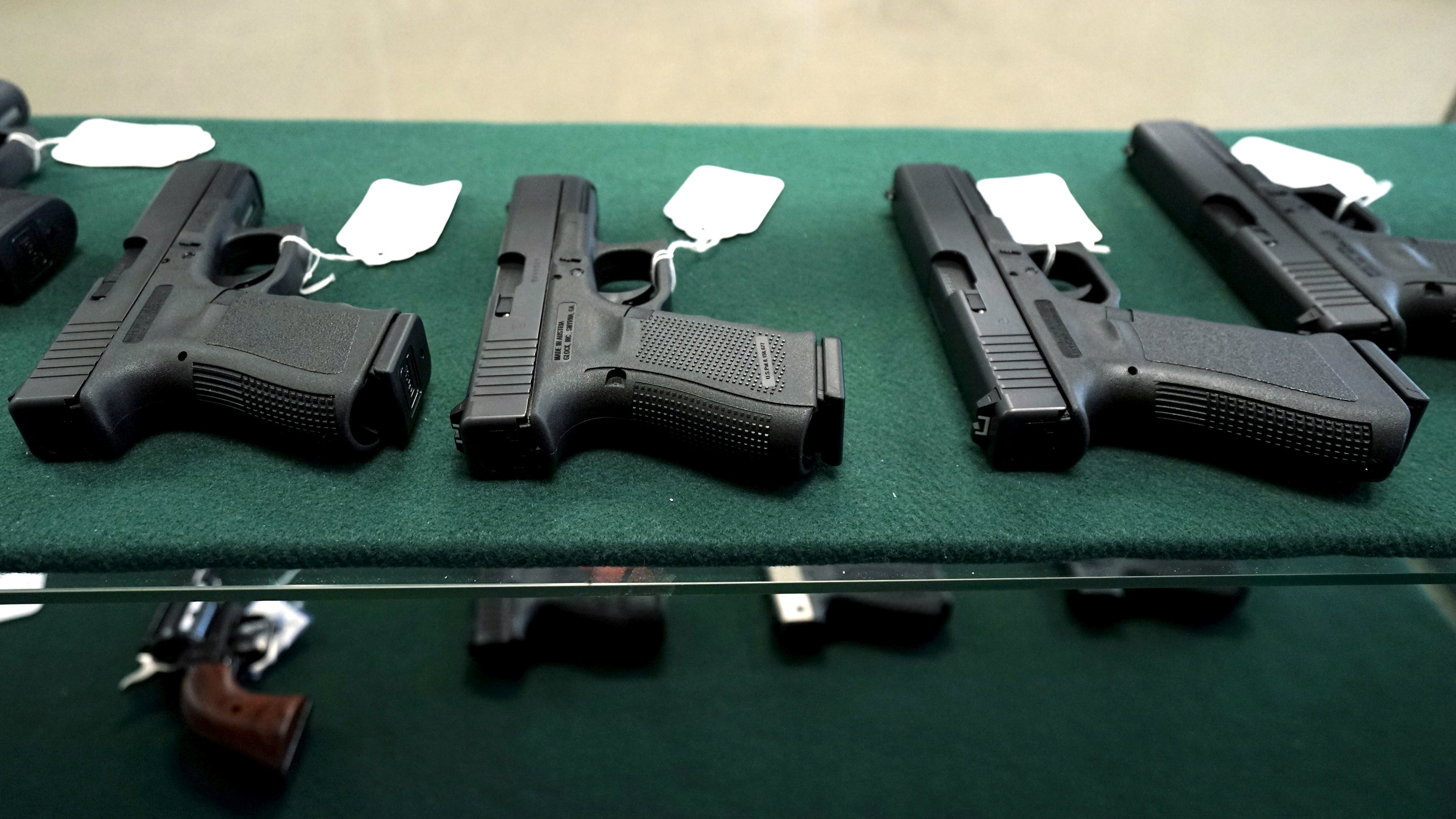 A selection of Glock pistols are seen for sale at the Pony Express Firearms shop in Parker, Colorado December 7, 2015.