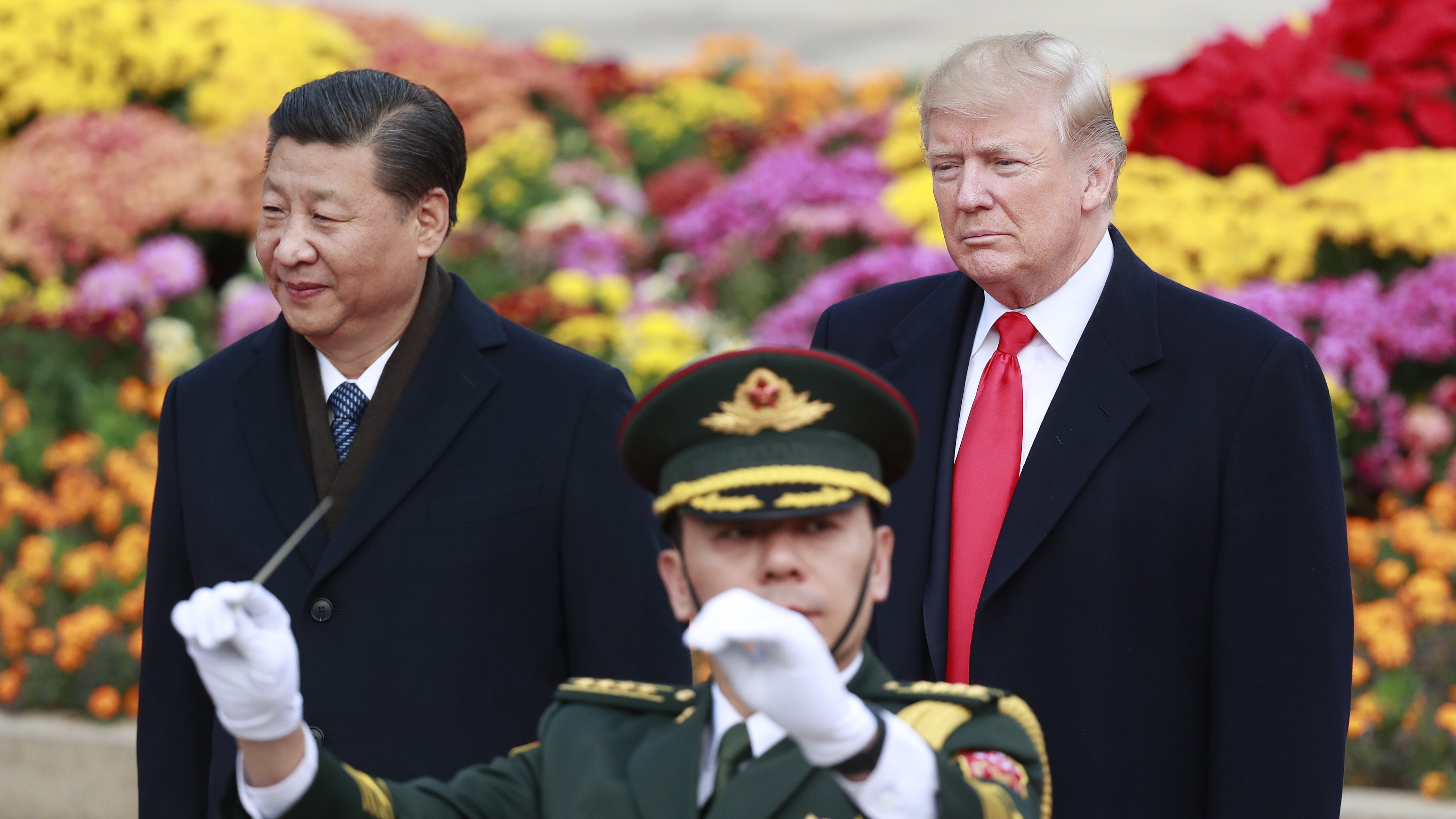 US President Donald J. Trump (R) and his Chinese counterpart Xi Jinping (L) watch a military band perform during a welcome ceremony in Beijing, China, 09 November 2017. US President Donald J. Trump is in China for a state visit from 08 to 10 November as part of his 12-day tour of Asia.