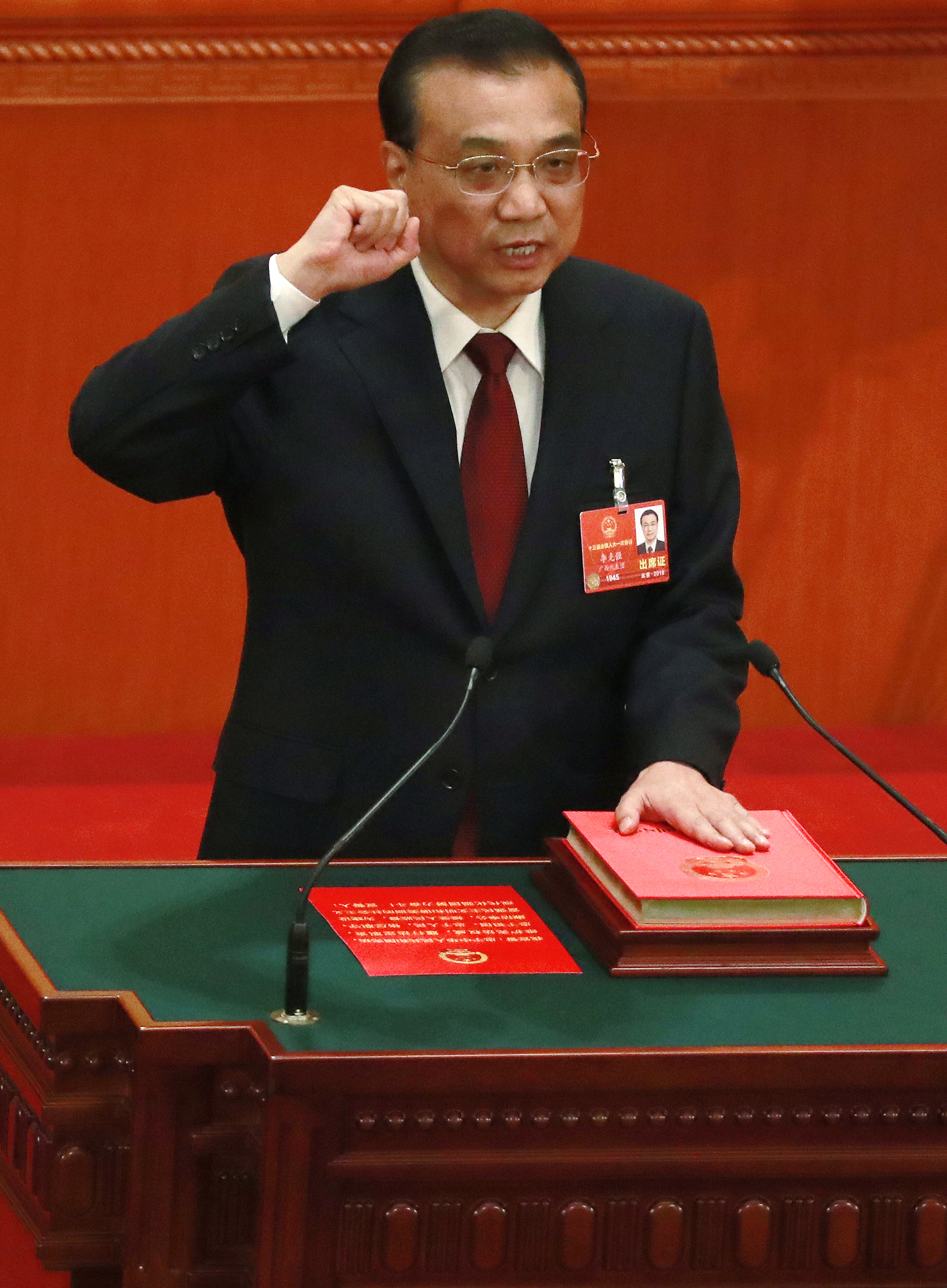Chinese Premier Li Keqiang swears an oath with his hand on the constitution after being re-elected as premier at the 6th plenary session of the first session of the 13th National People's Congress (NPC) at the Great Hall of the People in Beijing, China, 18 March 2018. Delegates of the NPC vote on 18 March to decide on the appointment of the premier, and vice chairpersons of the Central Military Commission (CMC). The NPC has over 3,000 delegates and is the world's largest parliament or legislative assembly though its function is largely as a formal seal of approval for the policies fixed by the leaders of the Chinese Communist Party. The NPC runs alongside the annual plenary meetings of the Chinese People's Political Consultative Conference (CPPCC), together known as 'Lianghui' or 'Two Meetings'.