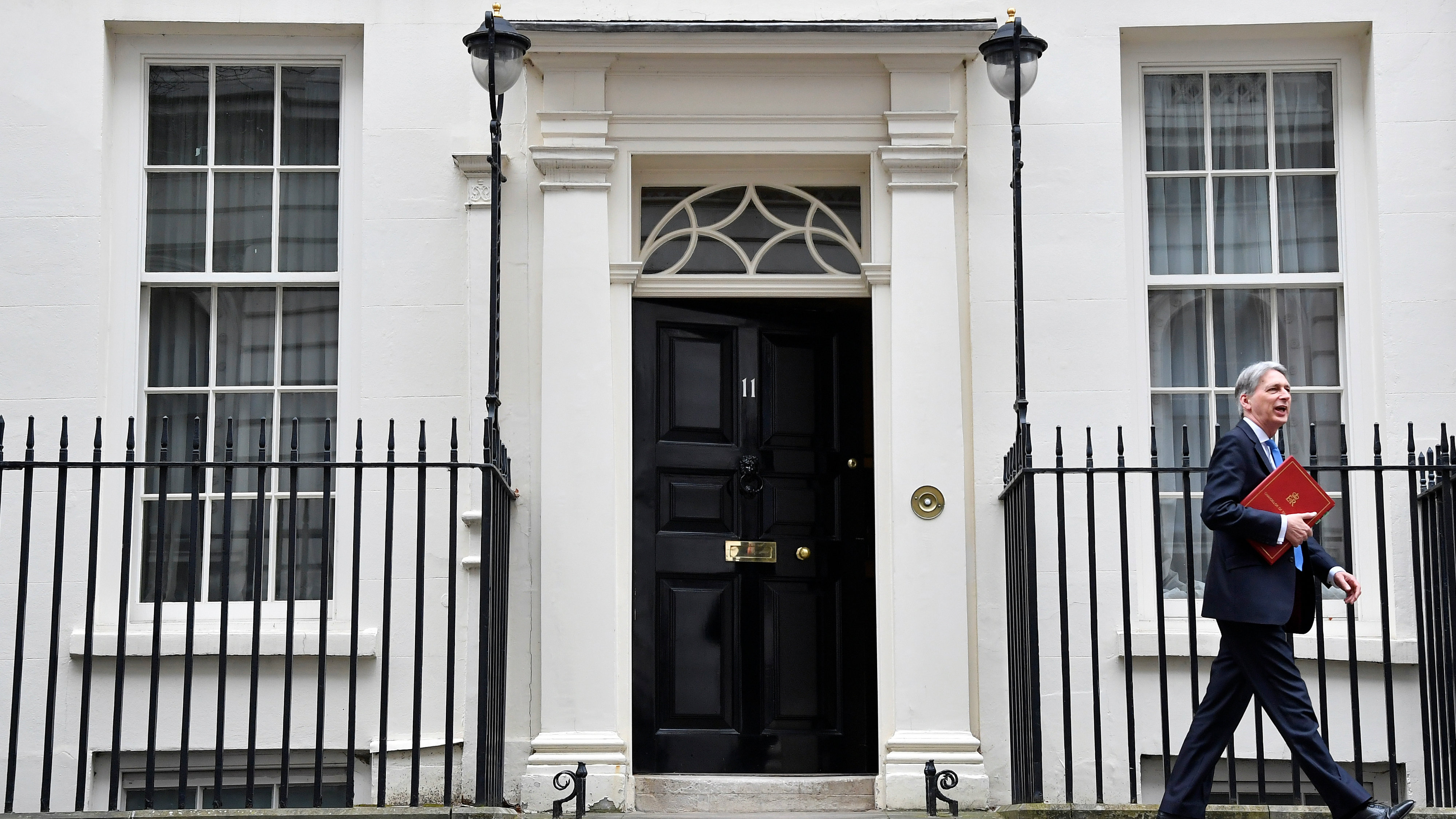 Britain's Chancellor of the Exchequer Philip Hammond leaves 11 Downing Street to deliver his half-yearly update on the public finance