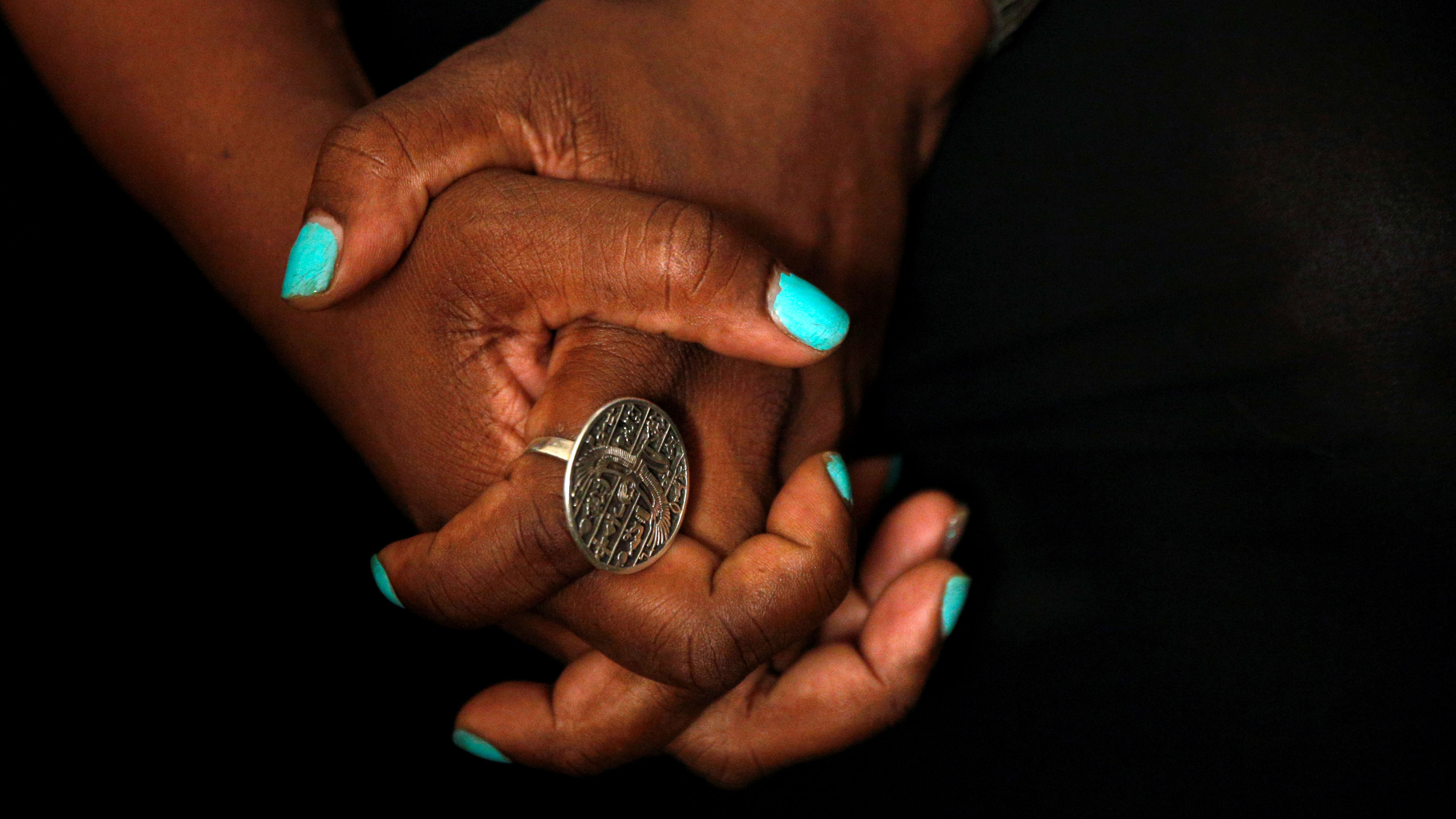 Tanya Walker, a 53-year-old transgender woman, activist and advocate, clinches her hand together during an interview at her apartment in New York City, U.S. September 7, 2016. Picture taken September 7, 2016.